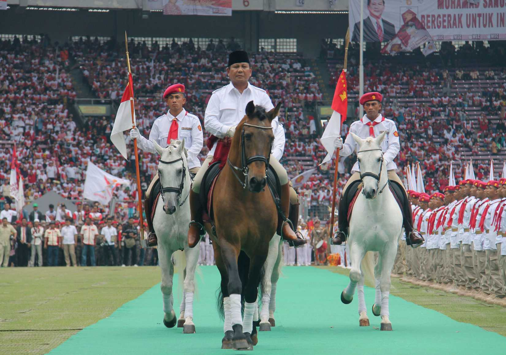 Retired general Prabowo Subianto rides a horse at a stadium in Jakarta during a campaign rally of the Gerindra party on March 23, 2014