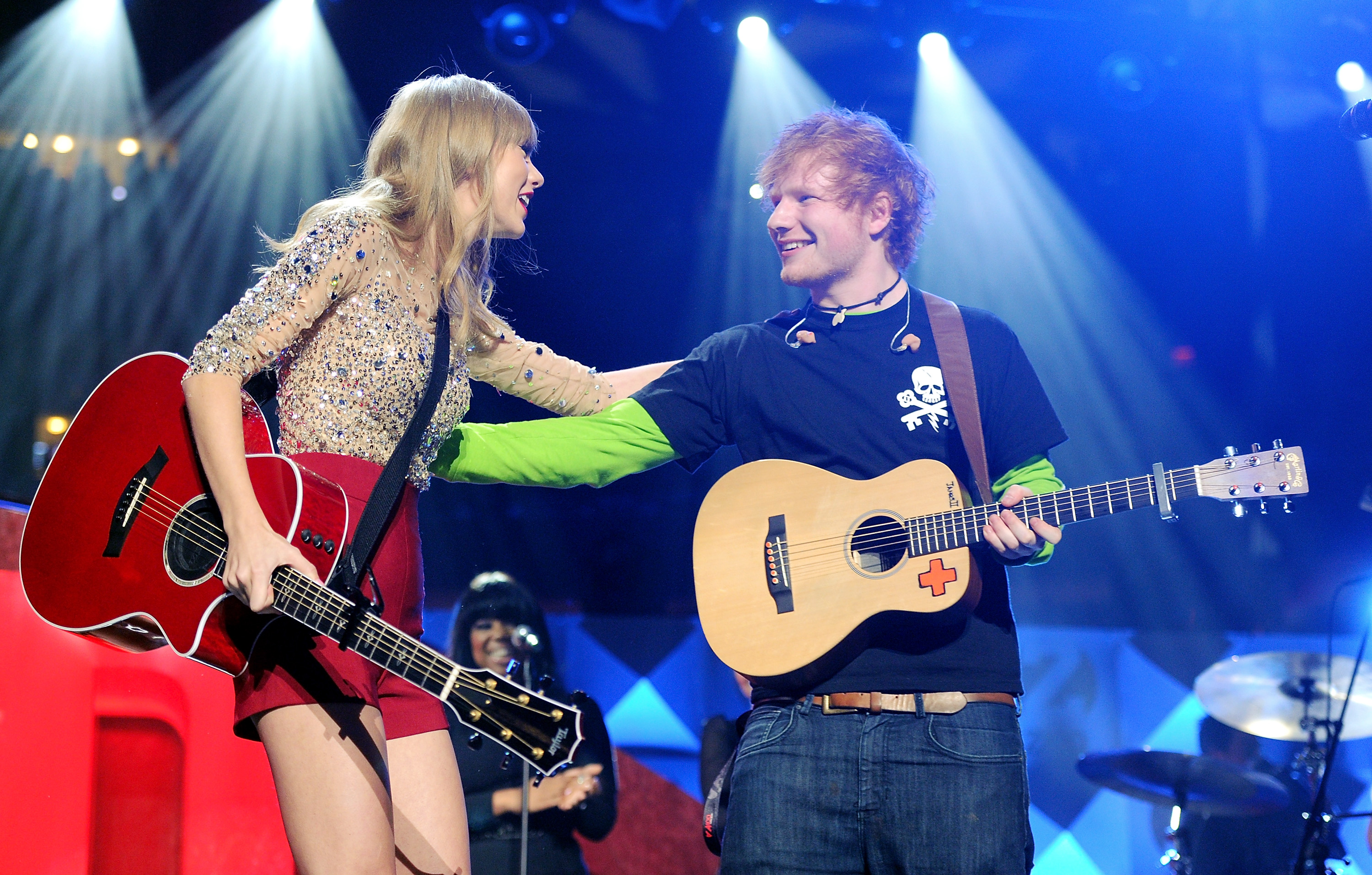 Singers Taylor Swift and Ed Sheeran perform together at Z100's Jingle Ball 2012 at Madison Square Garden on Friday Dec. 7, 2012 in New York City.