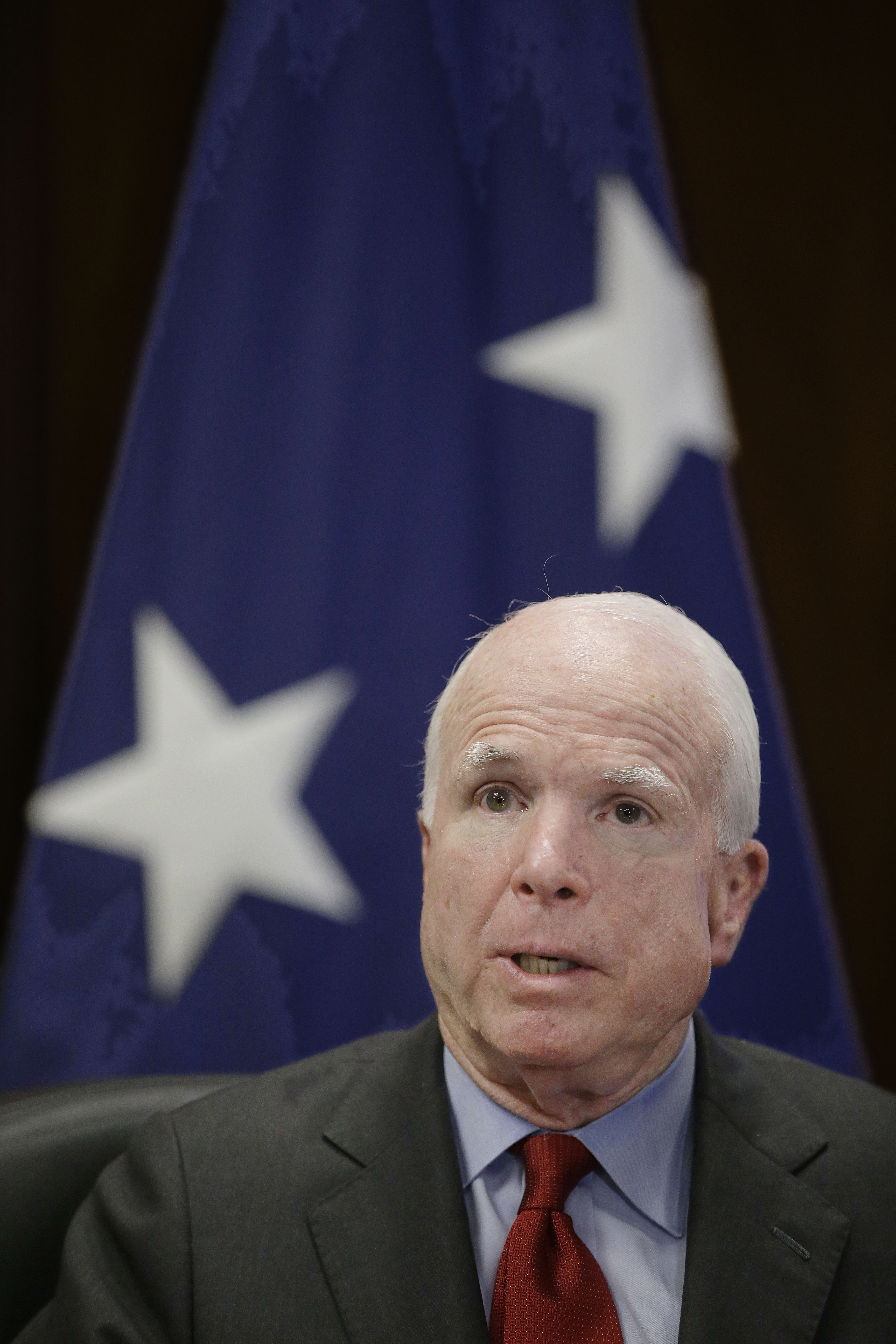 U.S. Senator John McCain, R-Ariz., responds to a reporter's question on Iraq during a media availability after he delivered an evening lecture at the U.S. Naval War College Thursday, June 12, 2014 in Newport, RI.