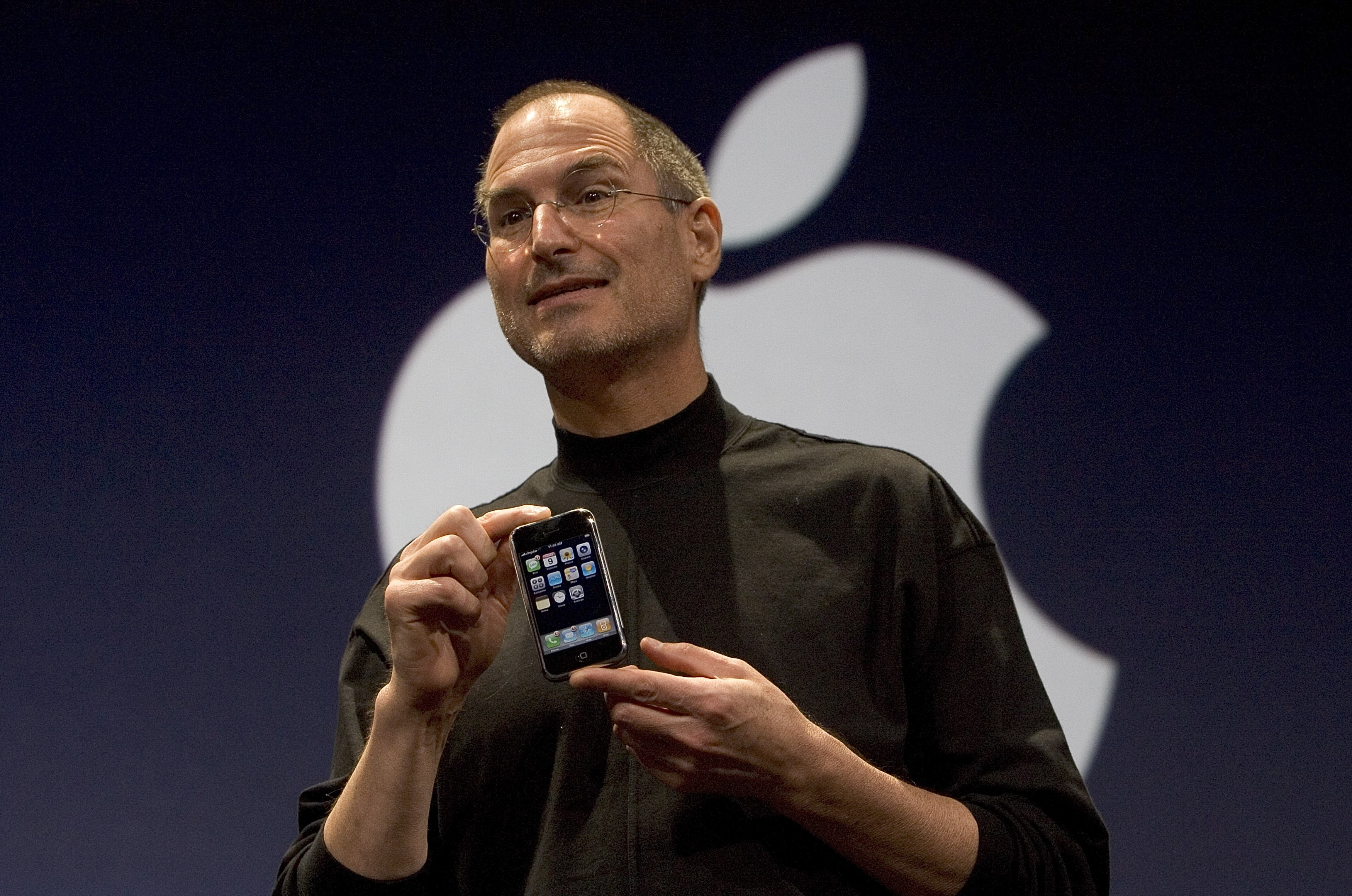 Apple CEO Steve Jobs holds up the new iPhone that was introduced at Macworld on January 9, 2007 in San Francisco.