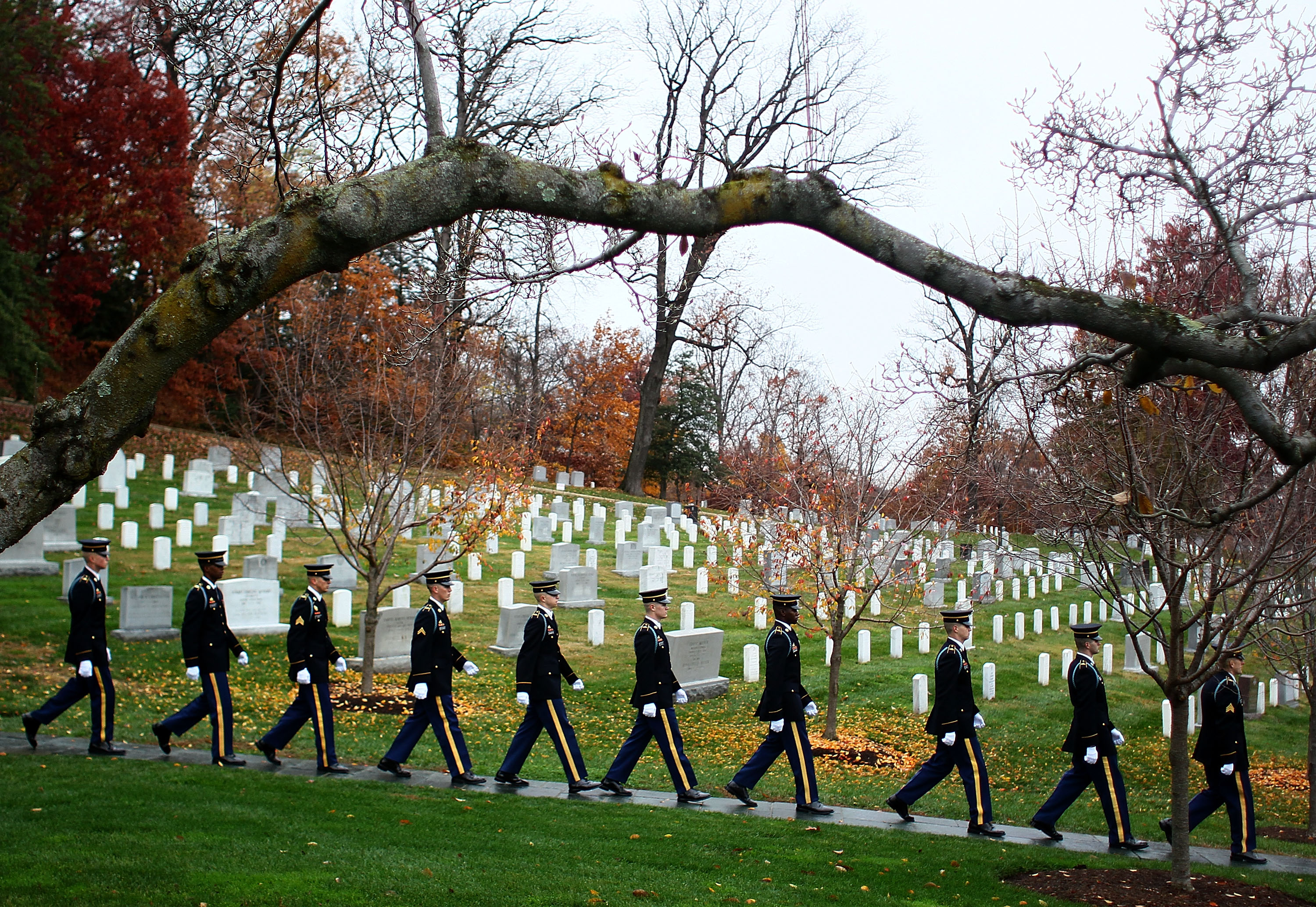 Members of the U.S. Army Old Guard walk away after a wreath-laying ceremony at President John F. Kennedy's gravesite at Arlington Cemetery in Va. on Nov. 17, 2011.