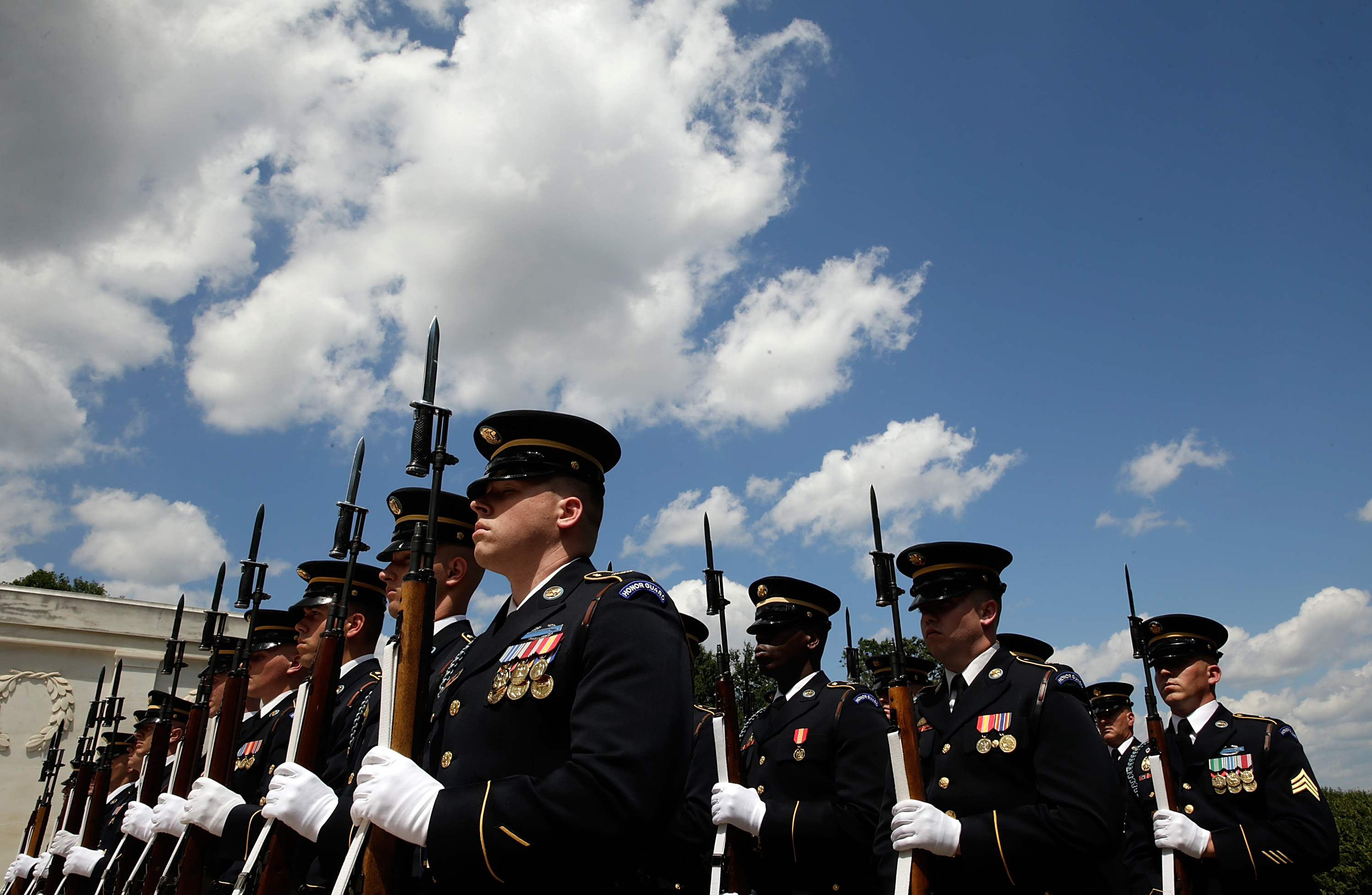 Members of the U.S. Army's  Old Guard take part in a wreath laying ceremony at the Tomb of the Unknown Soldier at Arlington National Cemetery in Va. on June 13, 2013.