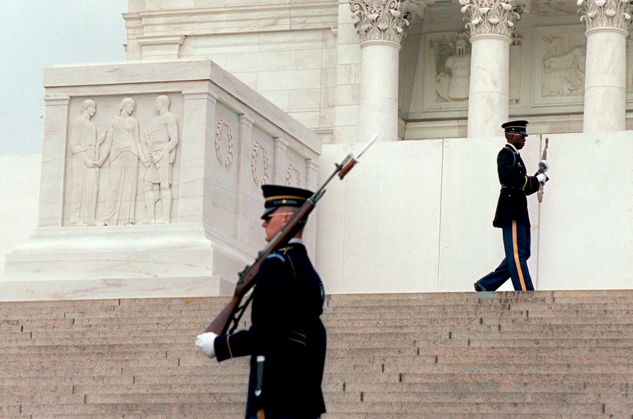Army soldiers of the Old Guard walk their posts at the Tomb of the Unknowns at Arlington National Cemetery in Va,  May 13, 1998.