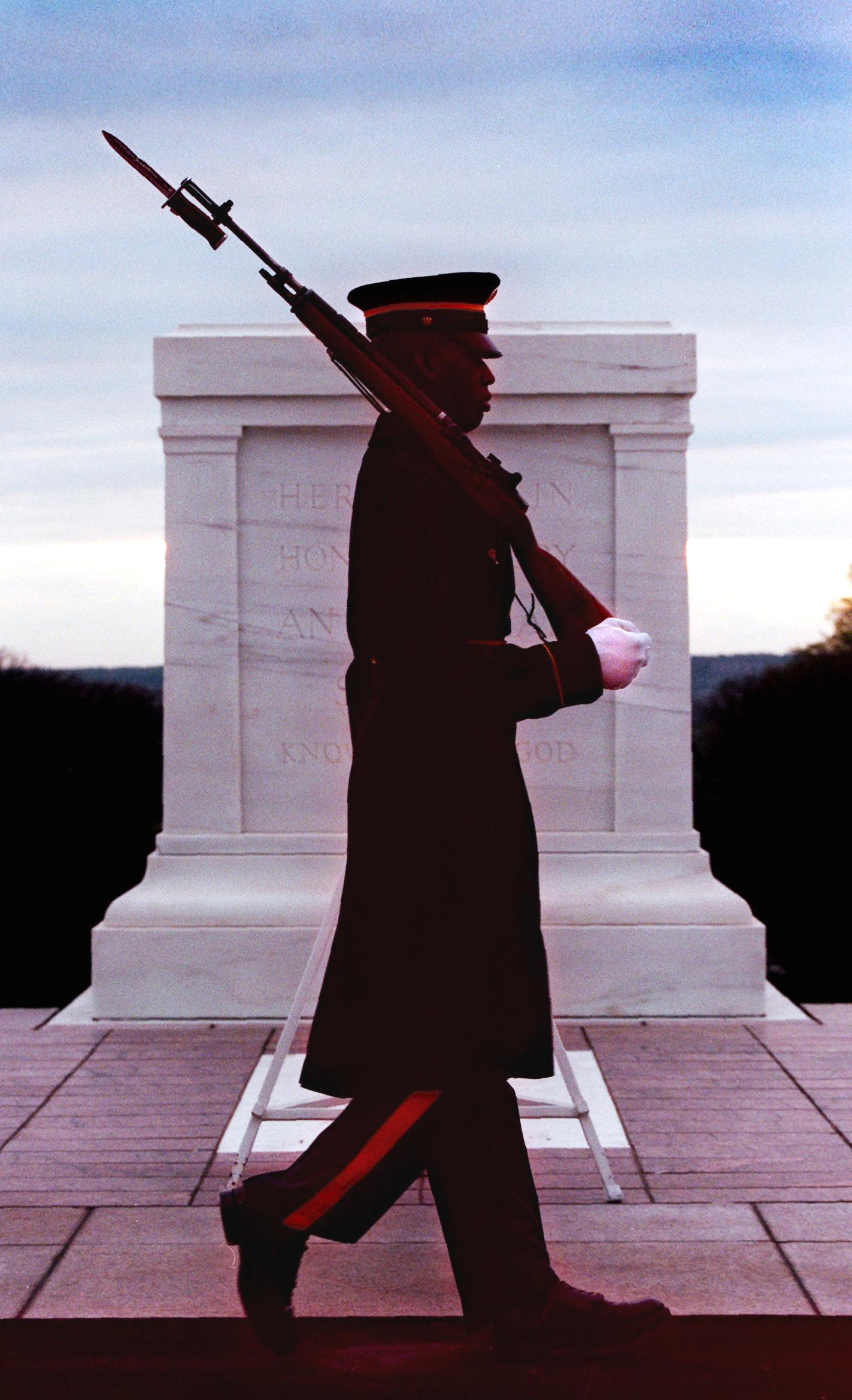 As dawn breaks, Tomb of the Unknowns Sentinel Sgt. Kenley Beazer, 25, of Augusta, Ga., takes the first full-dress shift of the day at Arlington National Cemetery in Va., April 5, 1998.