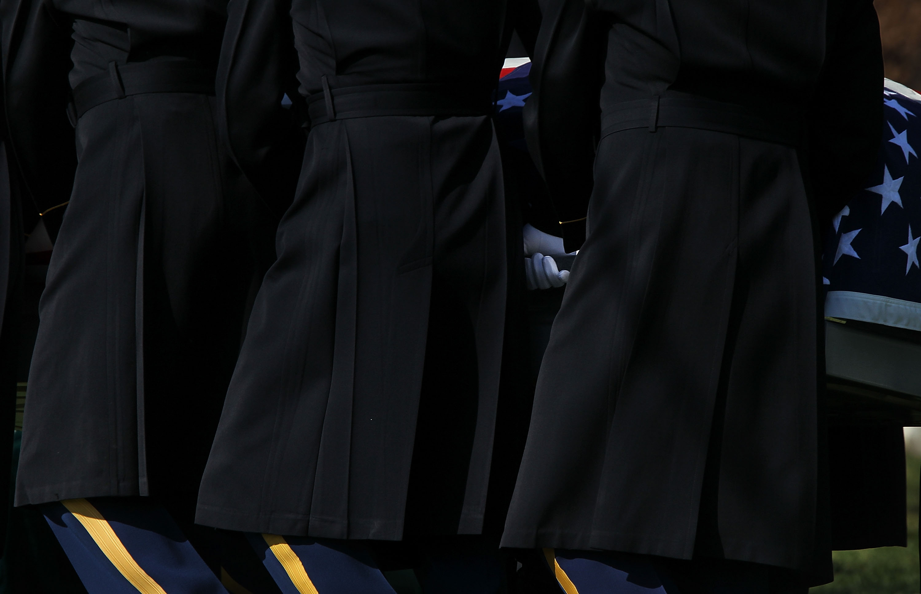 The flag-draped casket of U.S. Army 1st Lt. John E. Terpning of Mount Prospect, Ill. is carried to his final resting place by members of the Army's 3rd Infantry Regiment,  The Old Guard,  during his burial at Arlington National Cemetery in Va., April 3, 2013.