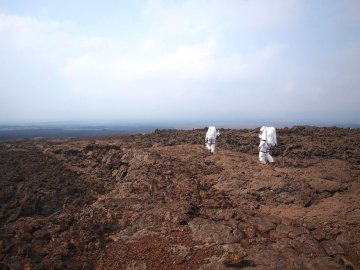 Scientist Lucie Poulet (right) from the DLR German Aerospace Center takes part in a simulated mission to Mars run by the University of Hawaii at Manoa in an image released on May 14, 2014.