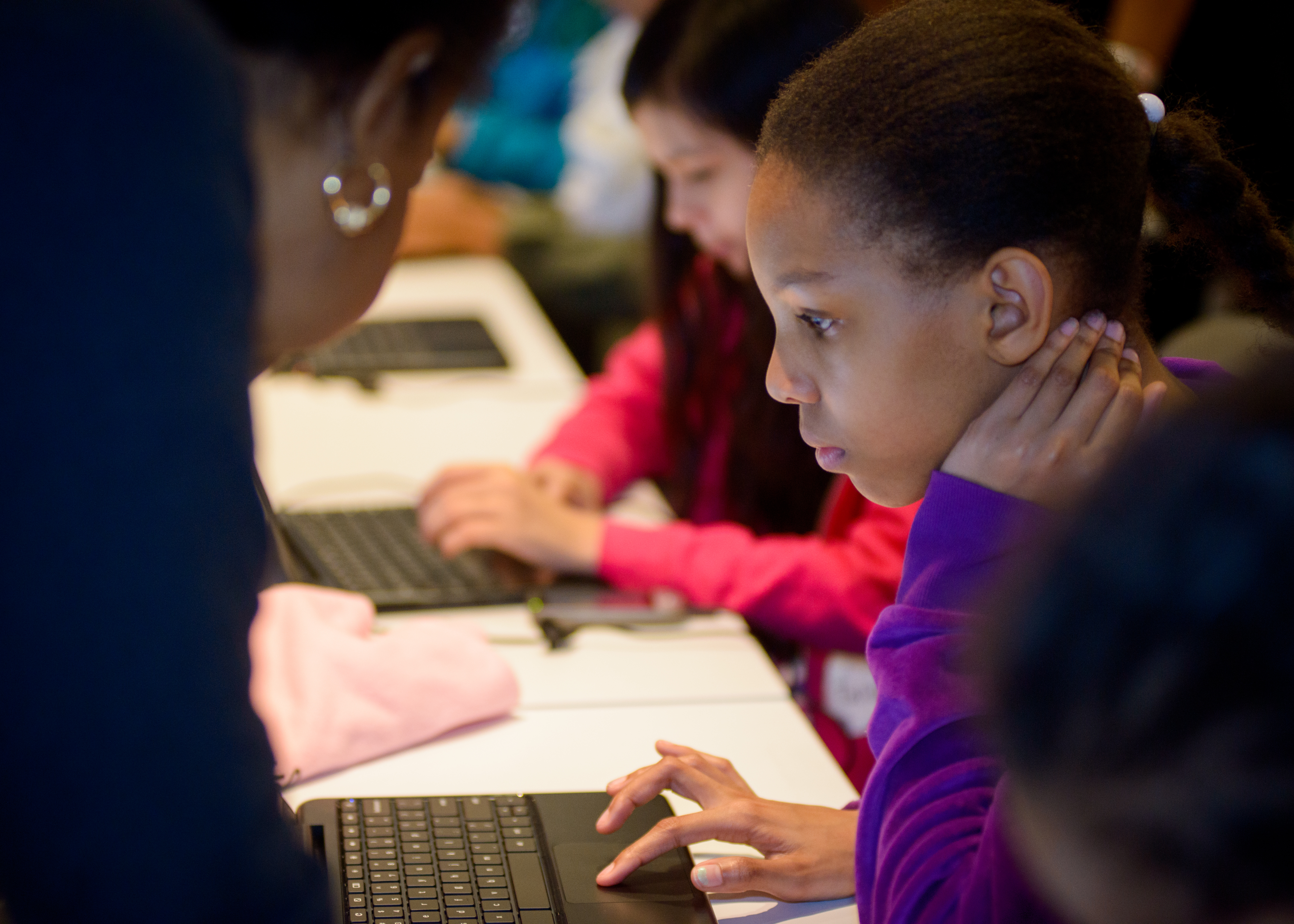 A young girl at a Black Girls Code program, who has partnered with , uses Made With Code
