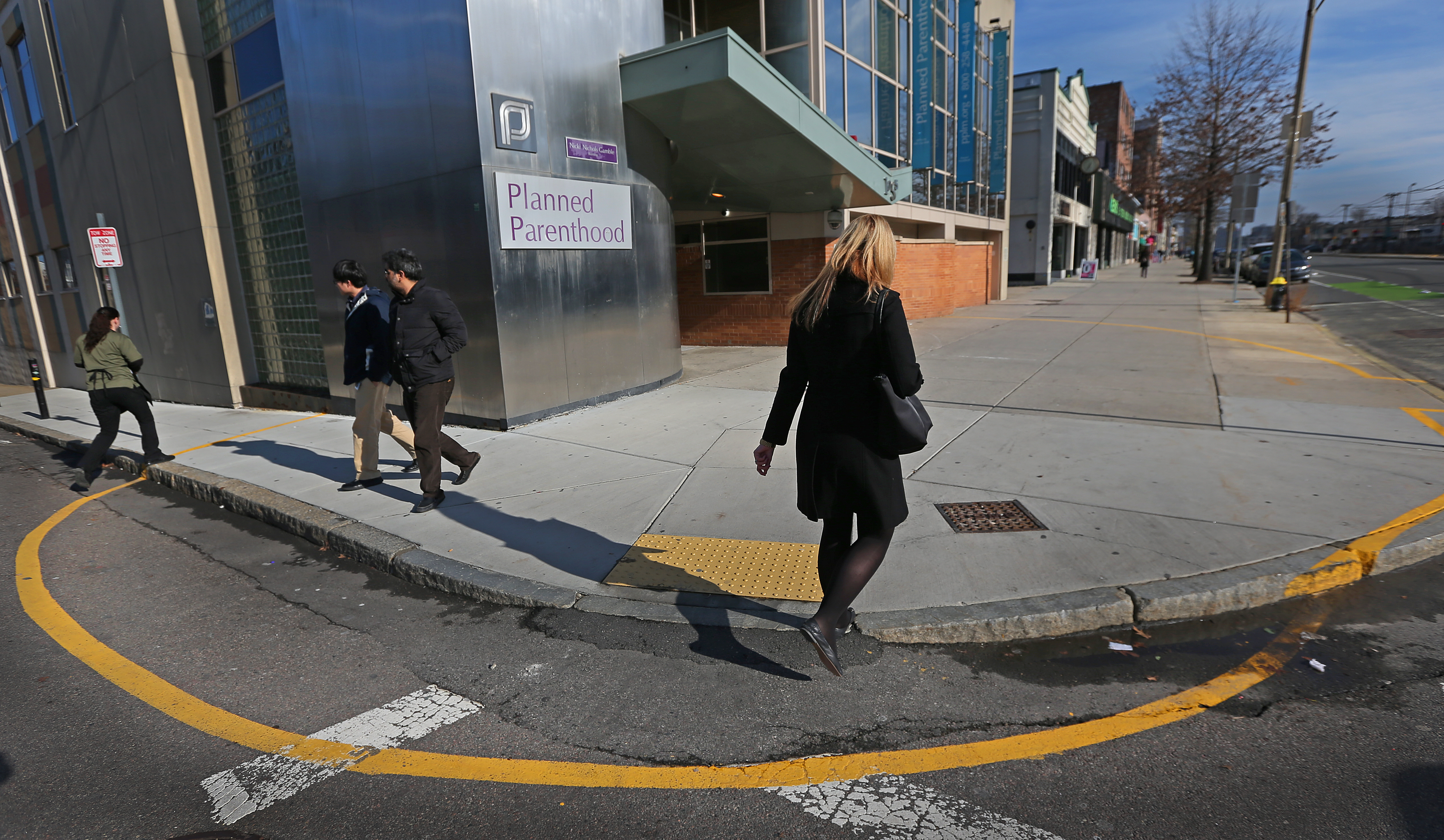 A yellow line is painted on the sidewalk and pavement surrounding Planned Parenthood Clinics at 1055 Commonwealth Ave., Boston, Jan. 15, 2014.