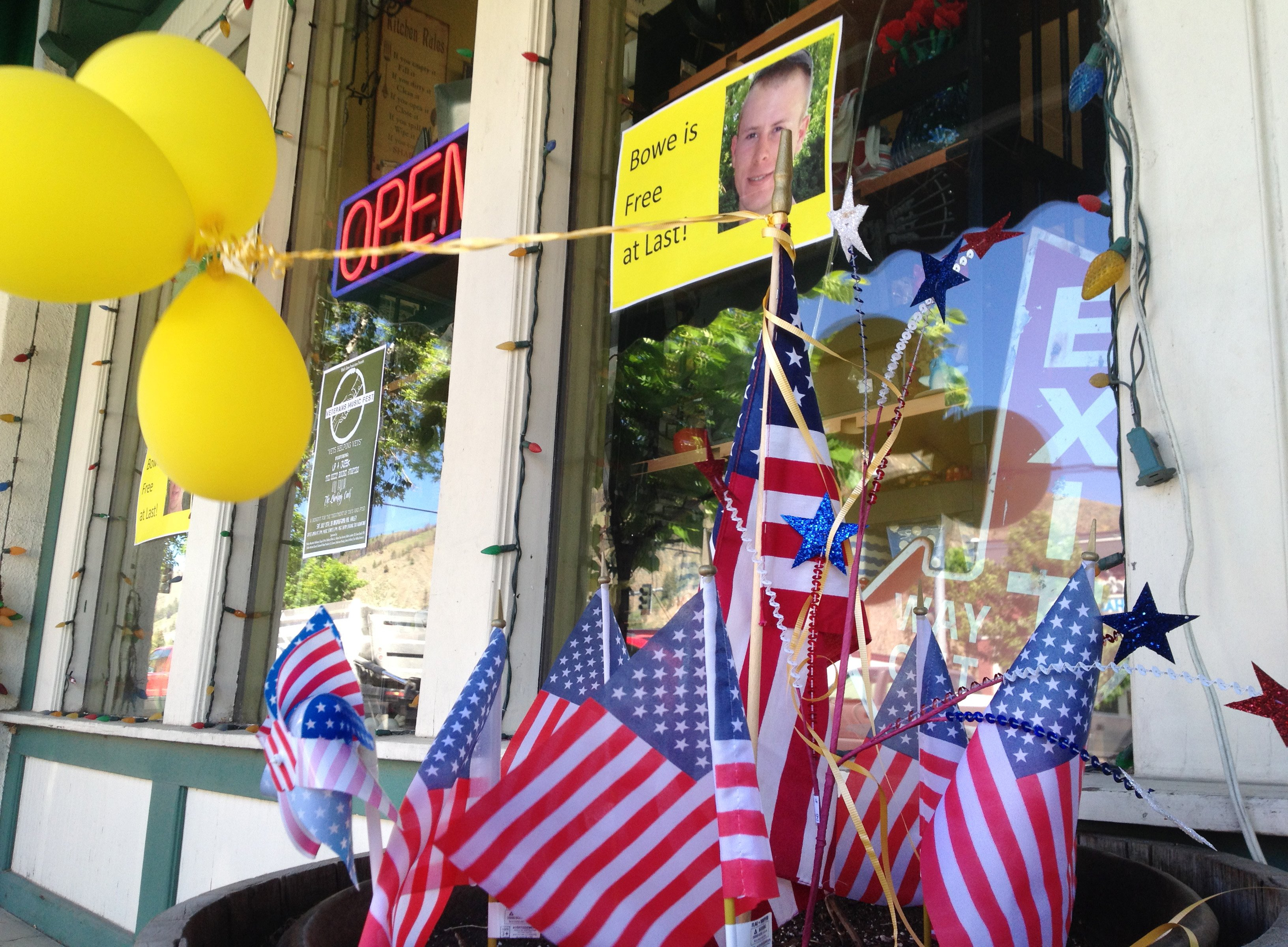 Flags and balloons, marking the release from captivity of Sgt. Bowe Bergdahl, adorn the sidewalk outside a shop in the soldier's hometown of Hailey, Idaho, on June 4, 2014.