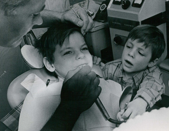 A boy afraid of the dentist observes his friend's dentist appointment in 1970.
