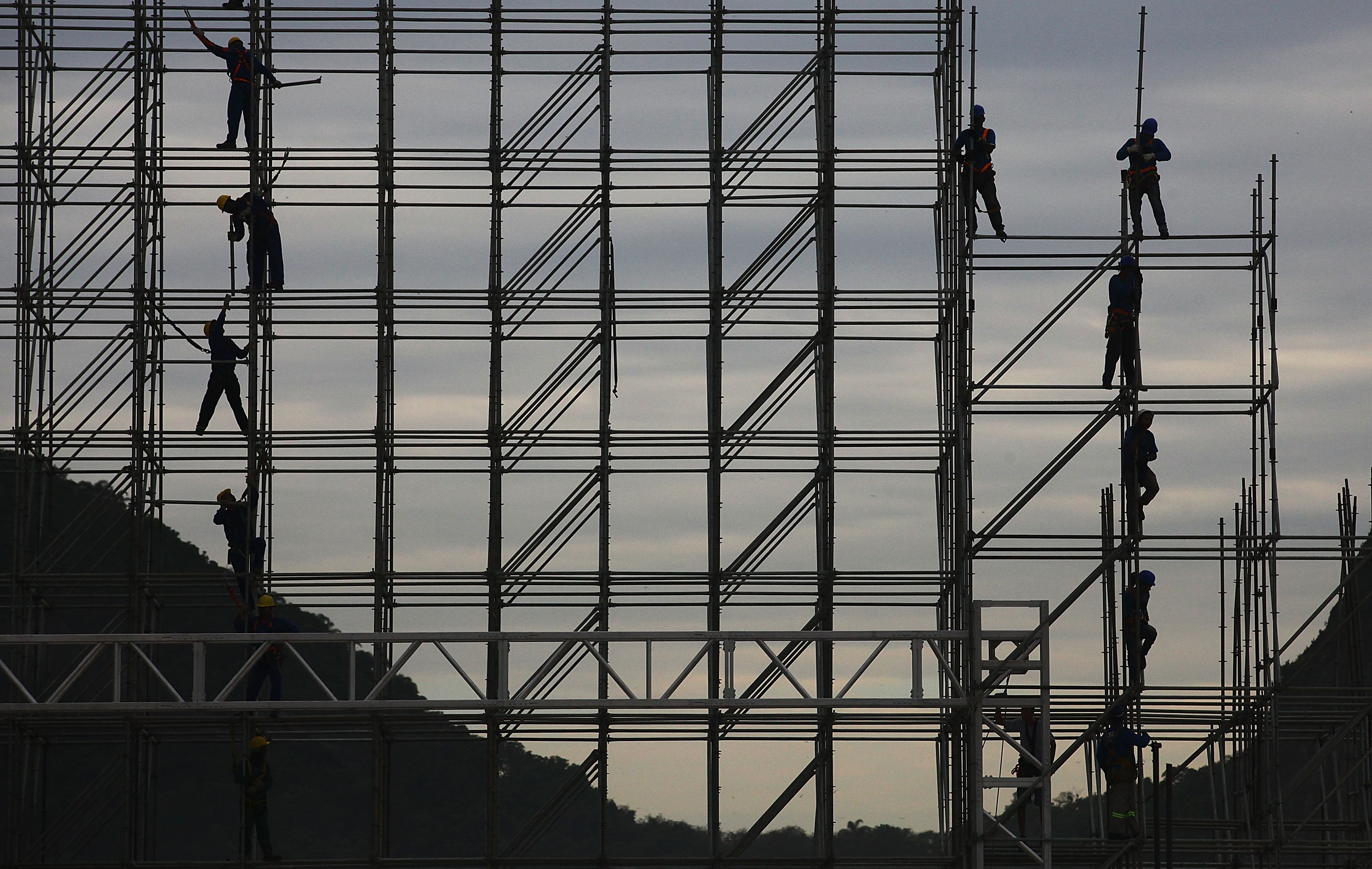 Workers construct the FIFA Fan Fest stage, where fans will be able to watch games broadcast live, on Copacabana Beach on June 1, 2014 in Rio de Janeiro.