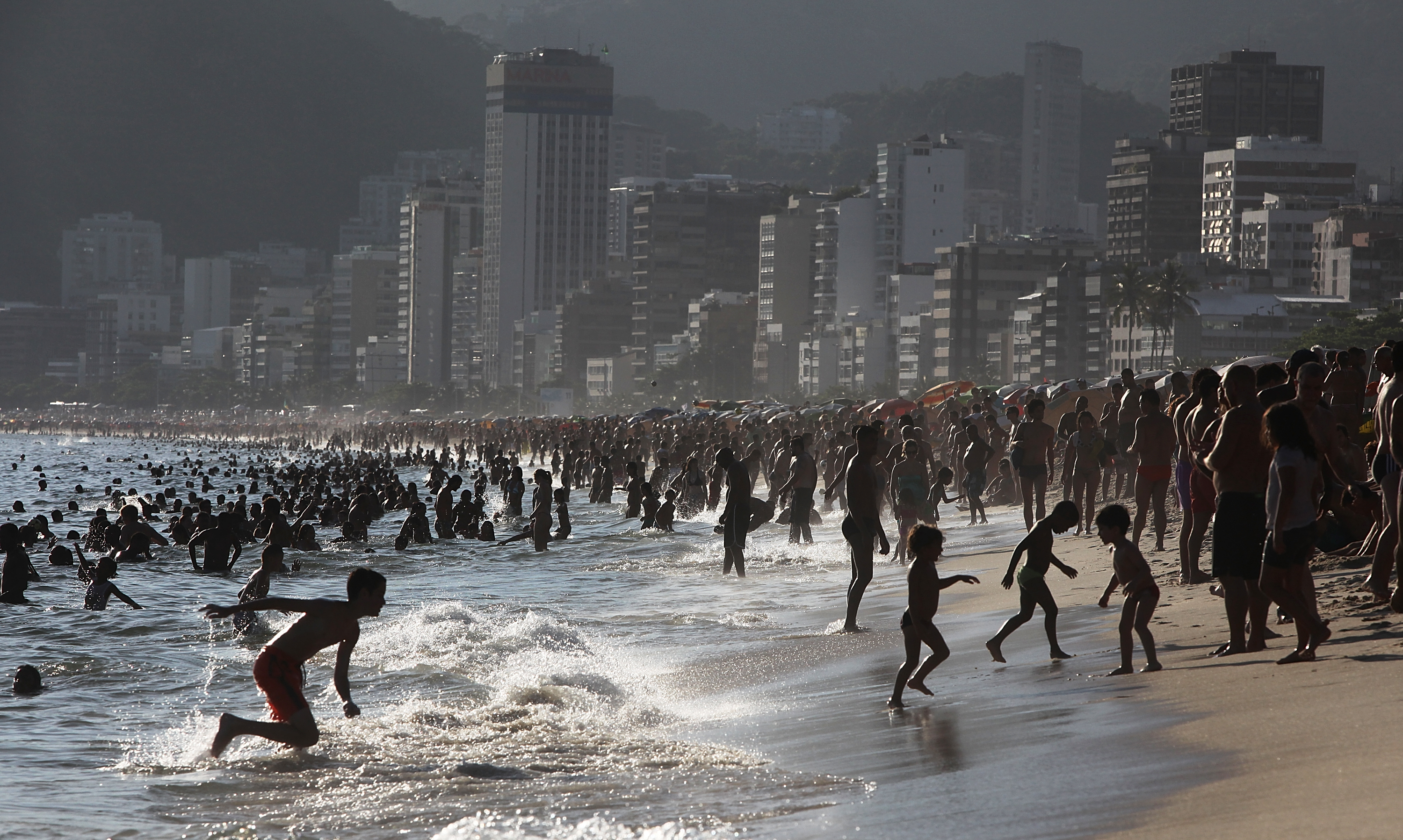 Crowds jam Ipanema Beach during a summer heat wave in the city on January 3, 2014 in Rio de Janeiro.