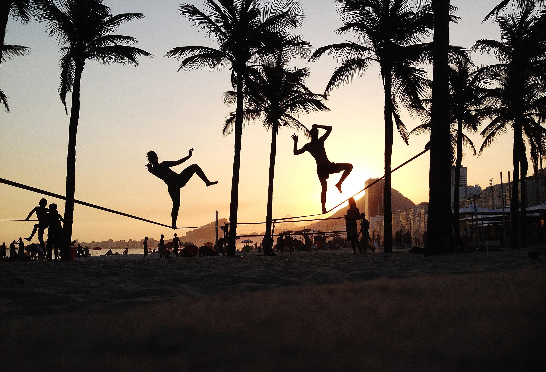 People practice slack lining on Copacabana Beach on February 8, 2014 in Rio de Janeiro.