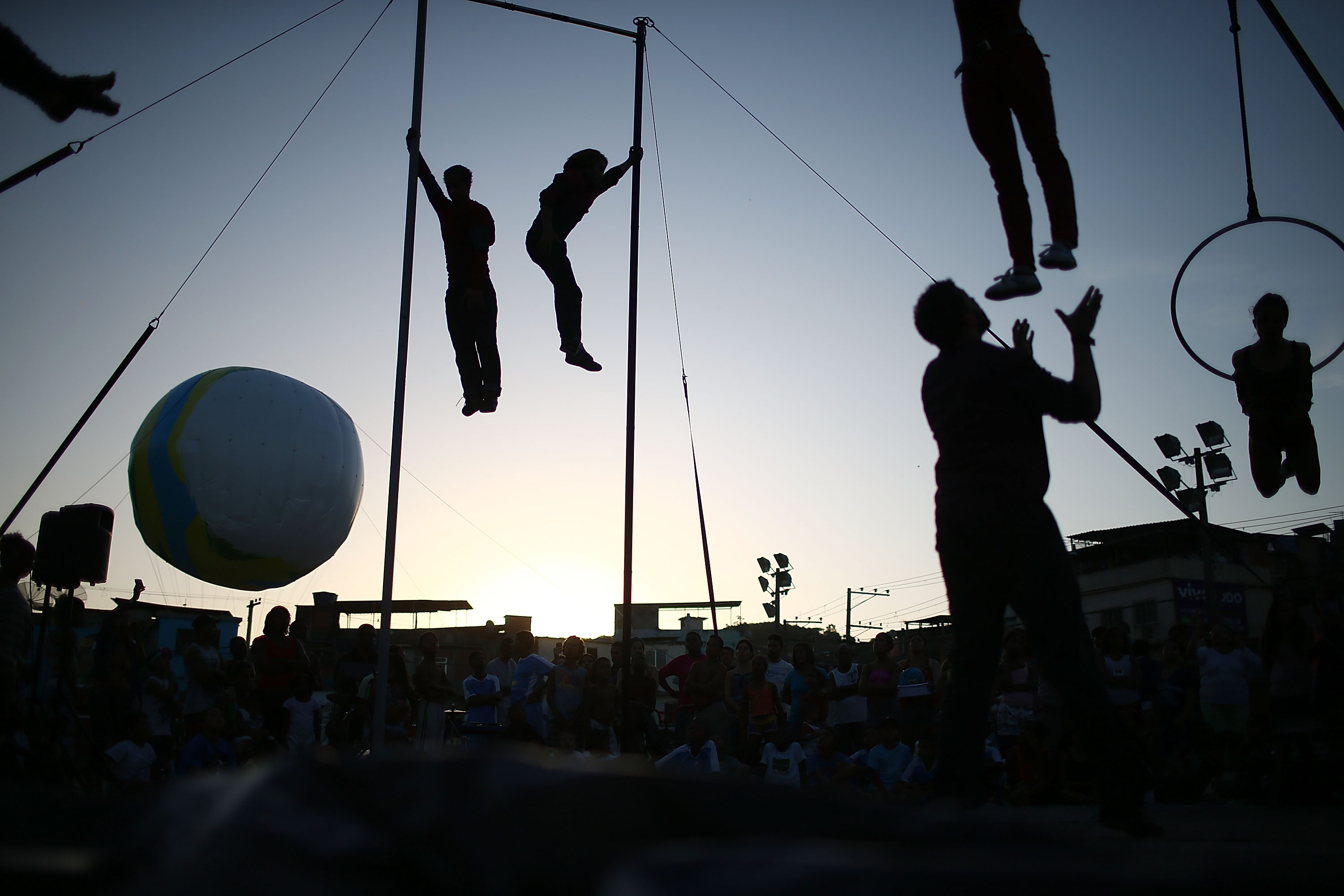 Artists from the Cia Base circus group perform in the show Futebol Voador (Flying Soccer) during the International Circus Festival in the Vila Cruzeiro favela on May 12, 2014 in Rio de Janeiro.