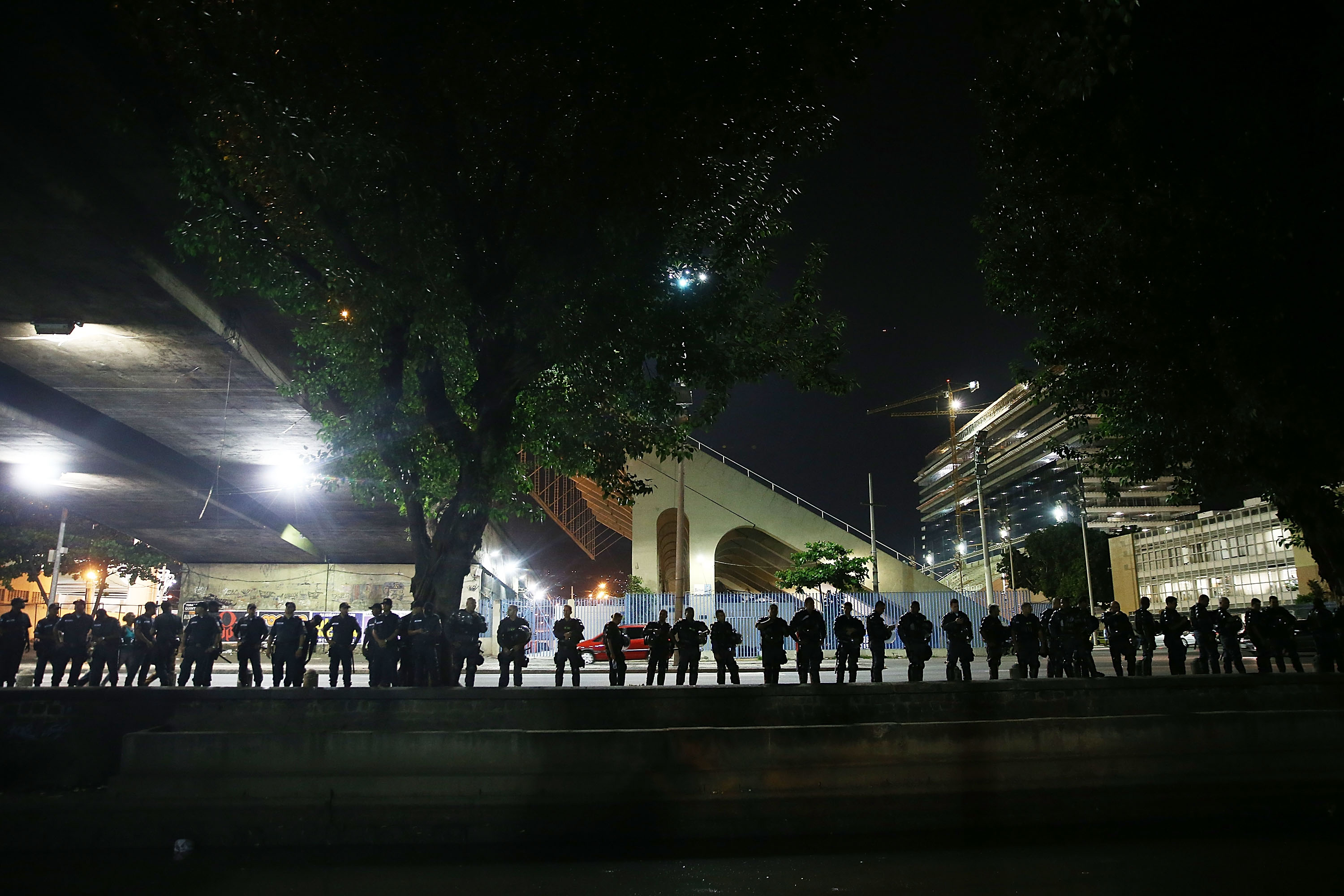 Military police keep watch a protest against the upcoming 2014 World Cup on May 15, 2014 in Rio de Janeiro.