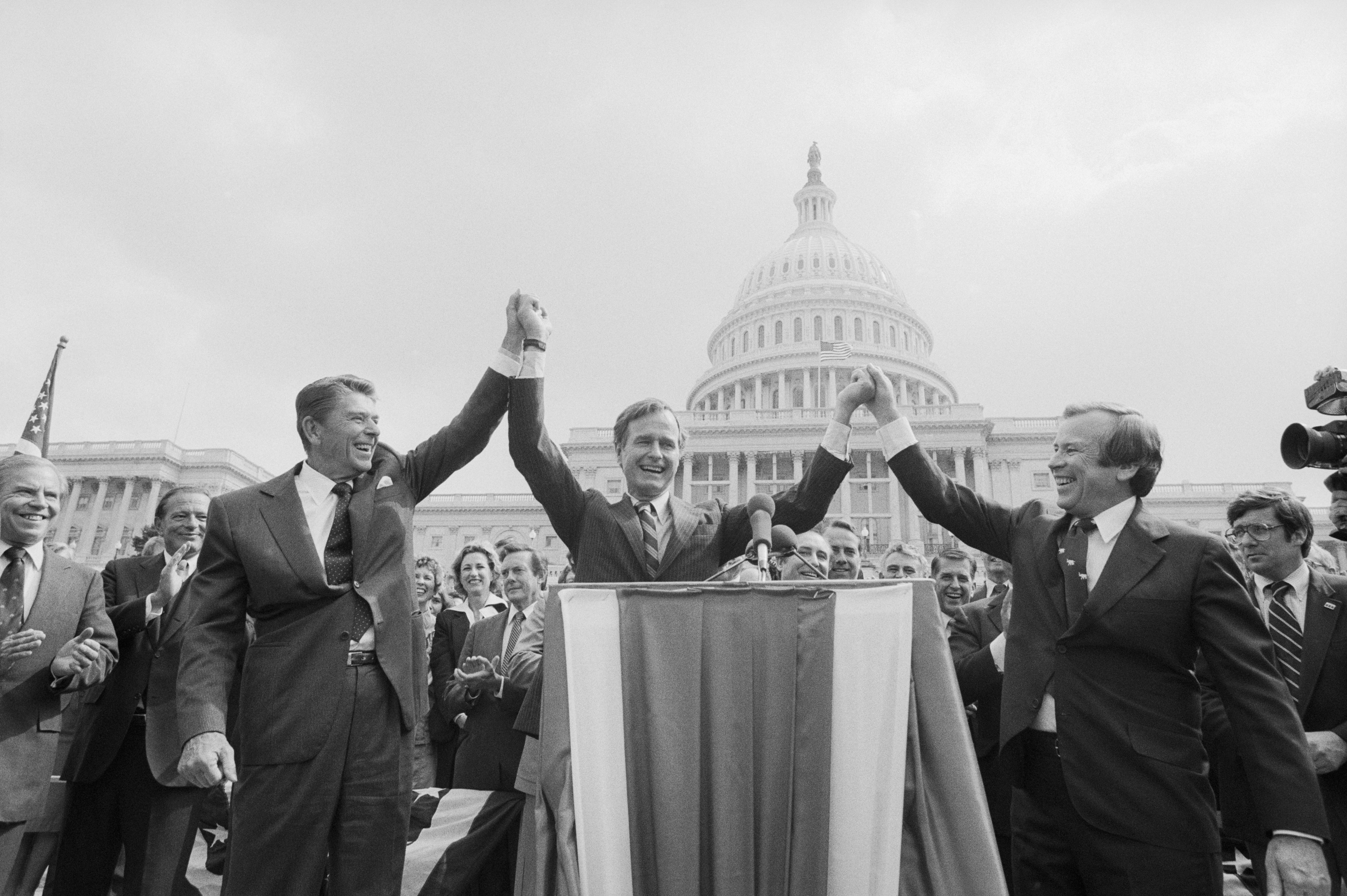 Reagan would prove to be the more popular conservative candidate in the race for the Presidency and would eventually gain the Republican nomination, but in a surprising turn of events, Reagan would pick Bush to be his vice presidential nominee. Here, the two candidates join Senate Majority leader Howard Baker for a rally on Capitol Hill in September 1980.