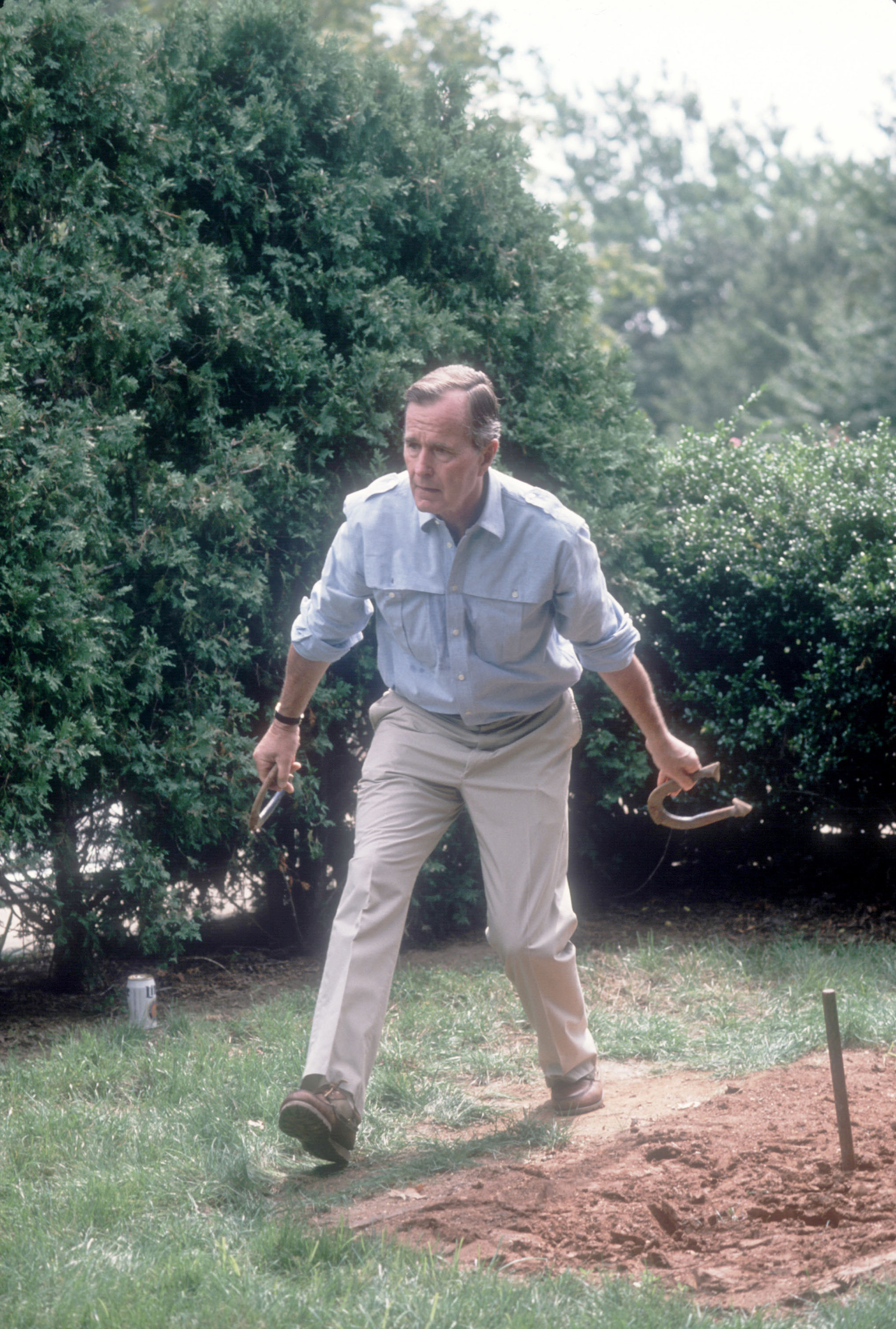 Vice President George H.W. Bush prepares to throw a horseshoe while on the campaign trail on  September 3, 1988. Bush and his running mate Dan Quayle defeated Michael Dukakis in the Presidential election.