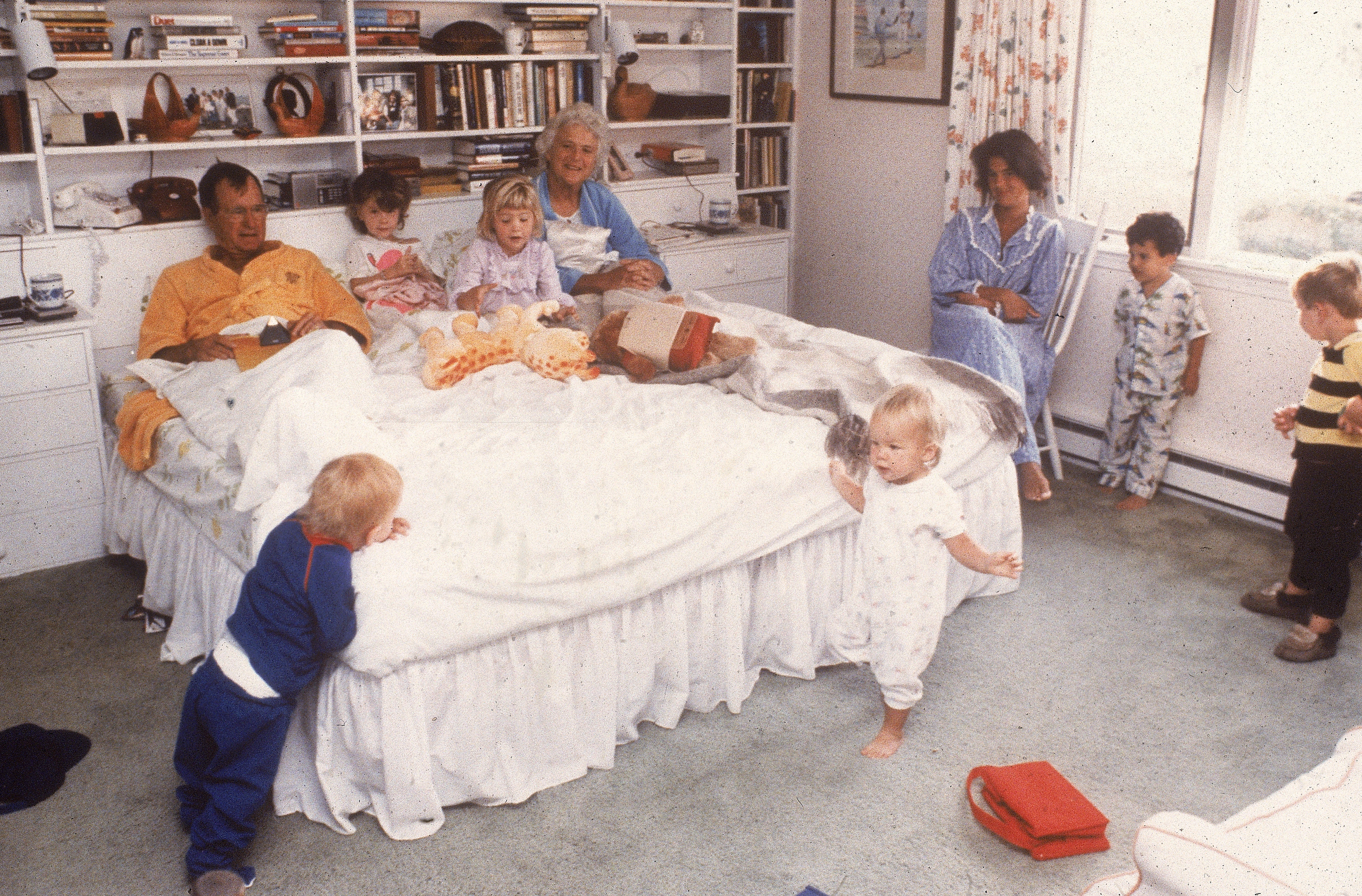 Vice president George  H.W. Bush and his wife Barbara relax in bed as their daughter and grandchildren join them at home in Kennebunkport, Maine in 1987.