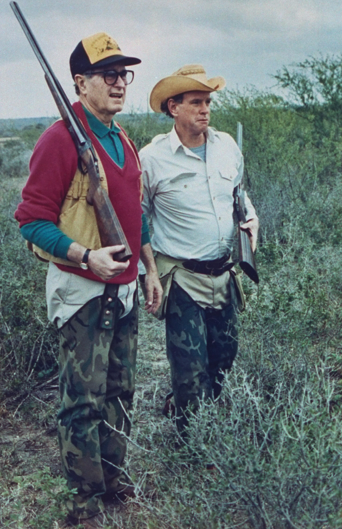George H.W. Bush dressed in hunting gear with friend & oil heir William Farish on a quail hunt at Lazy F Ranch on January 1, 1989.