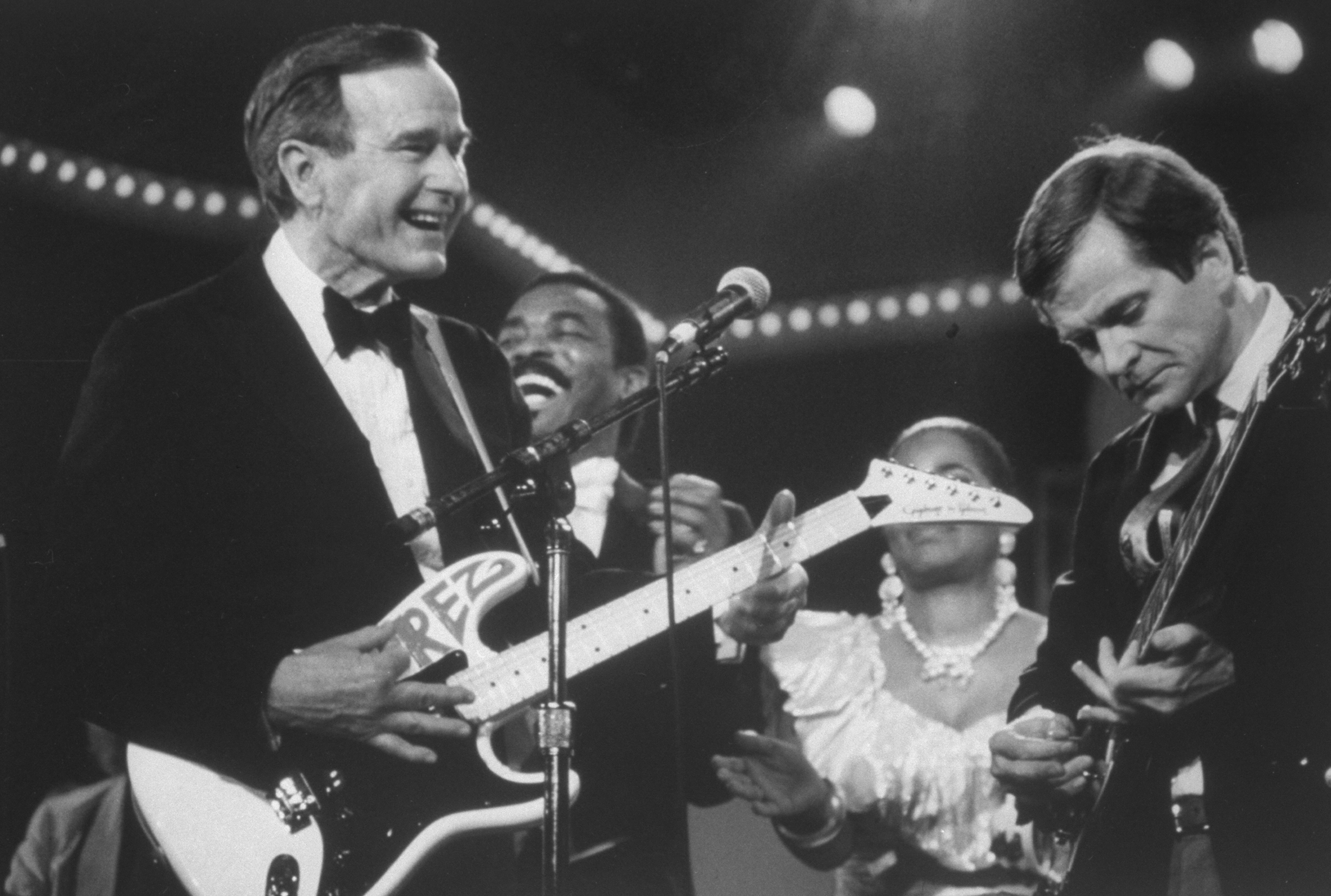 GOP Chairman Lee Atwater and President  George H.W. Bush playing guitar during the inaugural weekend bash on 1989.