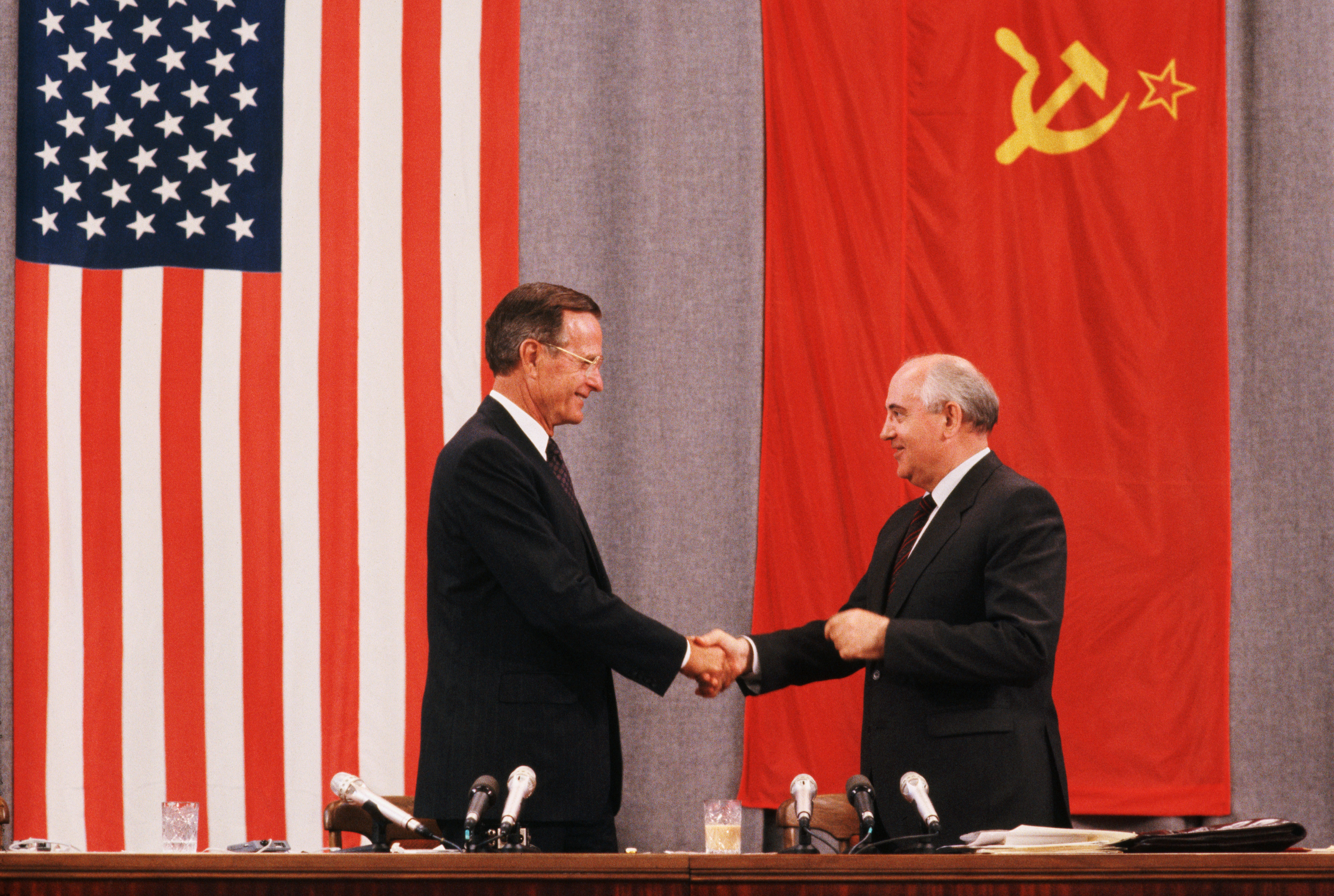 Presidents George H.W. Bush and Mikhail Gorbachev shake hands at the end of a press conference about the peace summit in Moscow on July 31, 1991.
