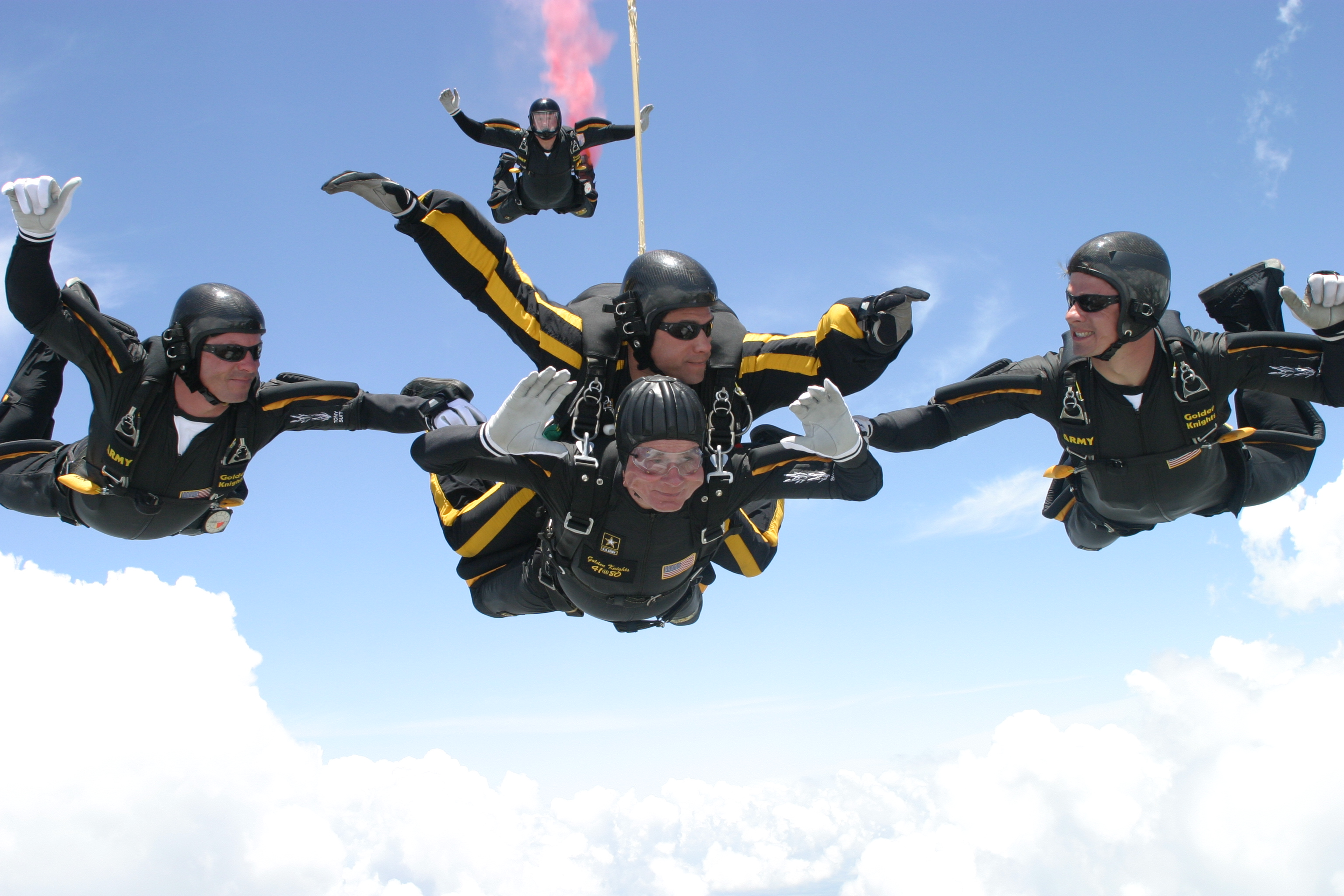 George H.W. Bush celebrates his 80th birthday with a tandem parachute jump over Texas A&M University with the U.S. Army Golden Knights parachute team. on June 13, 2004 in College Station, Texas.