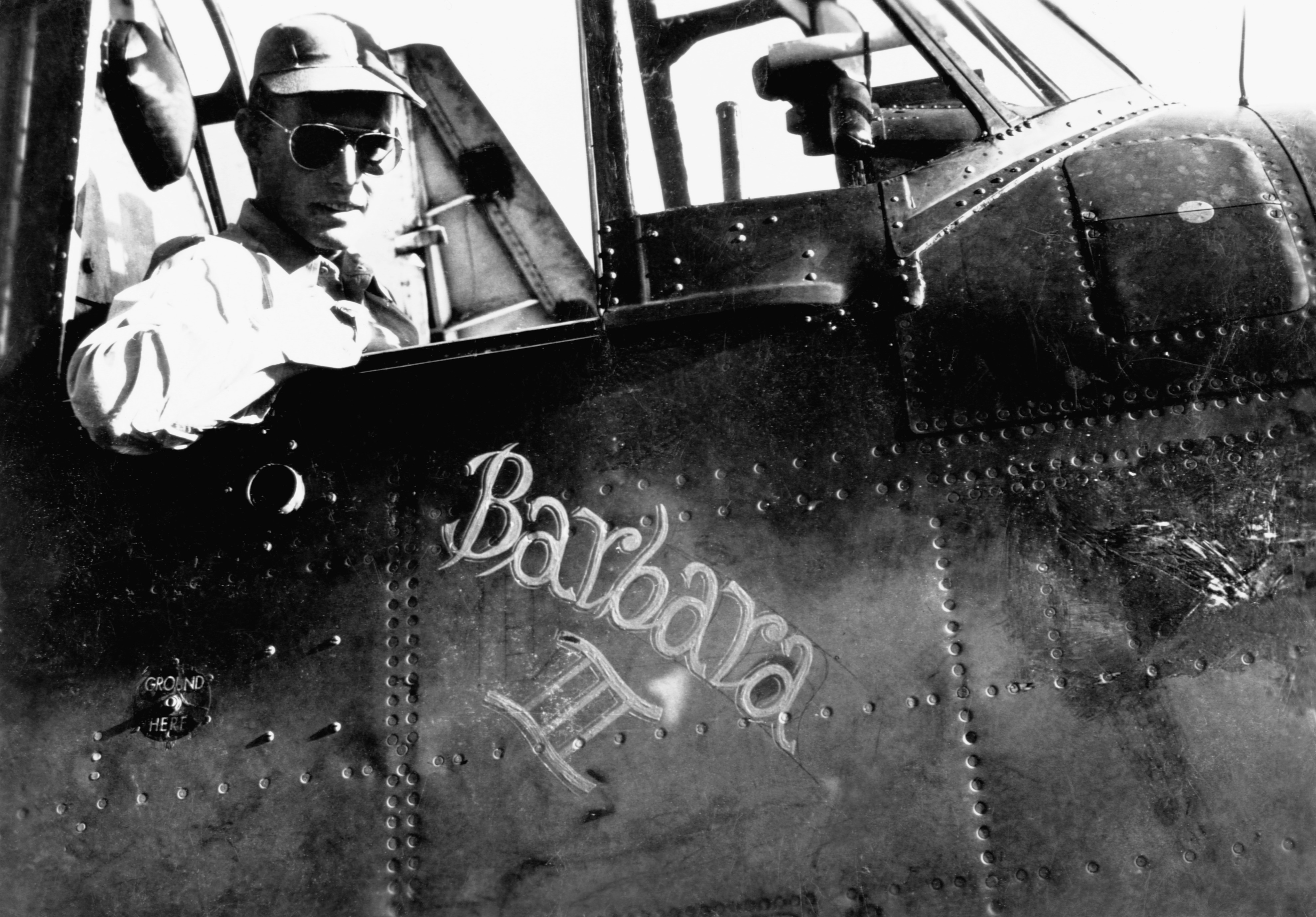 """U.S. Navy pilot George H.W. Bush sits in the cockpit of his torpedo bomber """"Barbara III"""", named after his girlfriend and future wife Barara Pierce. Bush was in the navy from 1943-1945."""