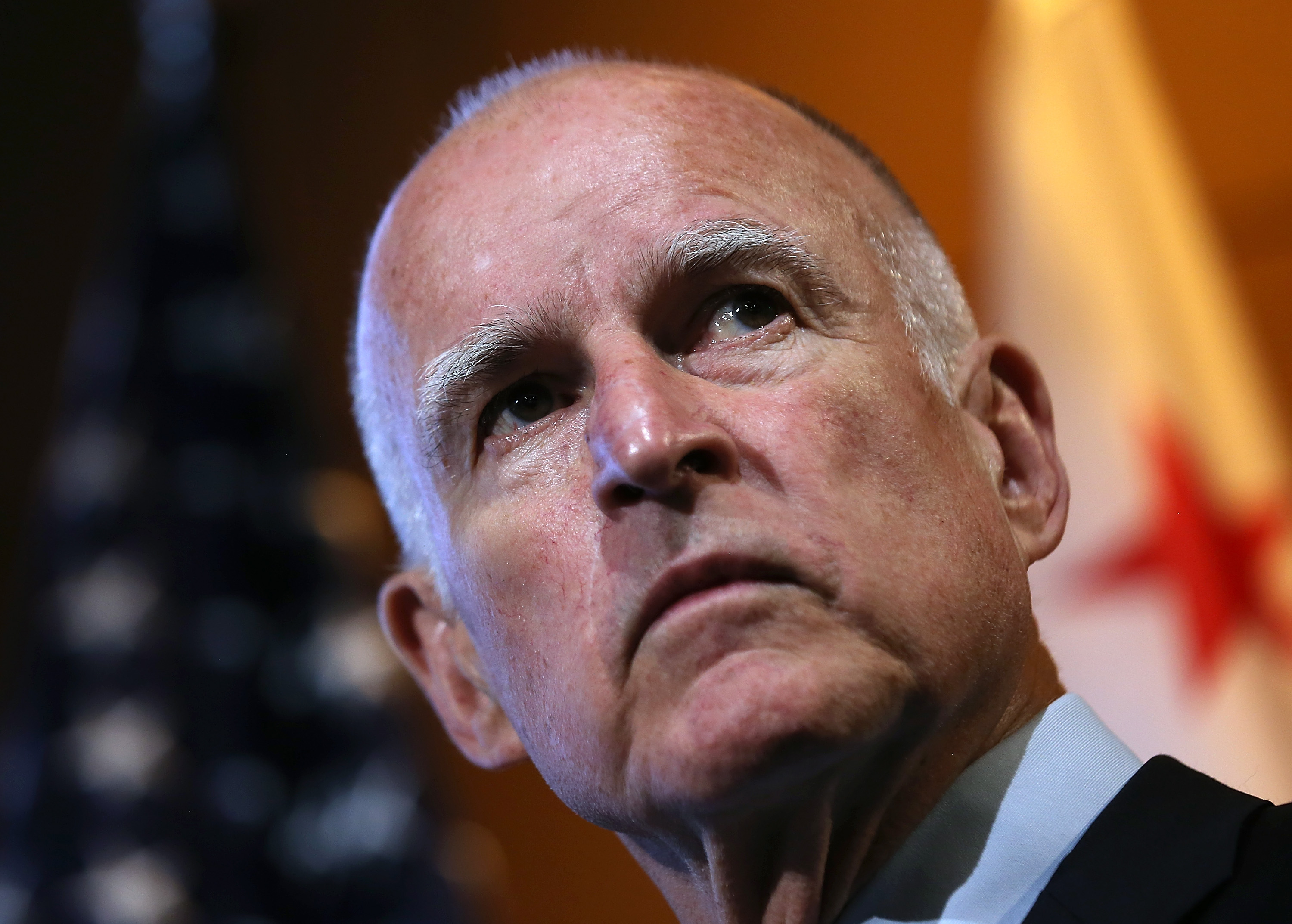 California Gov. Jerry Brown looks on during a news conference at Google headquarters on September 25, 2012.