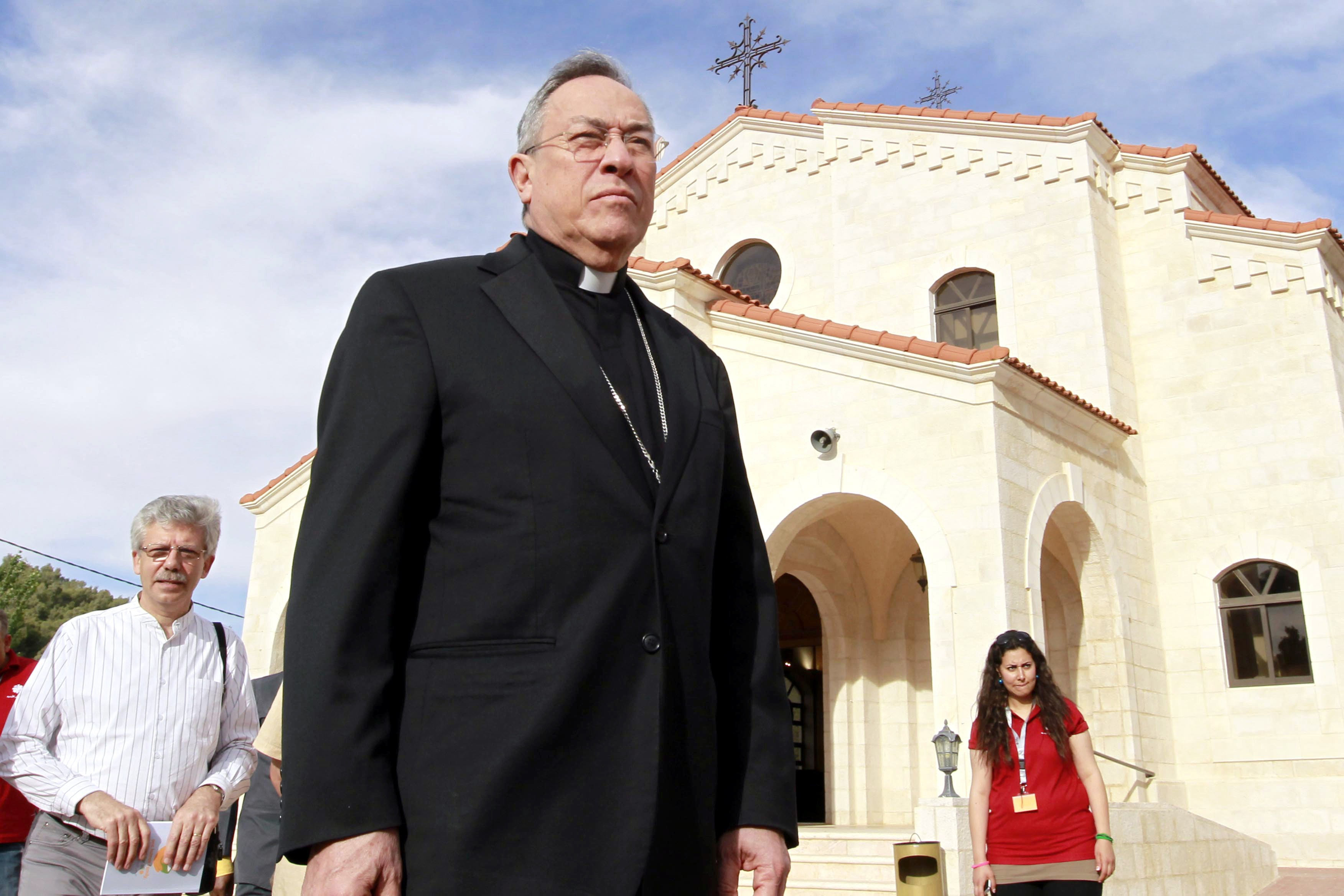 Cardinal Oscar Andres Rodriguez Maradiaga, President of Caritas Internationalis, looks on during a visit to the Regina Pacis Centre (Our Lady of Peace Church) in Amman, Jordan on May 18, 2014.