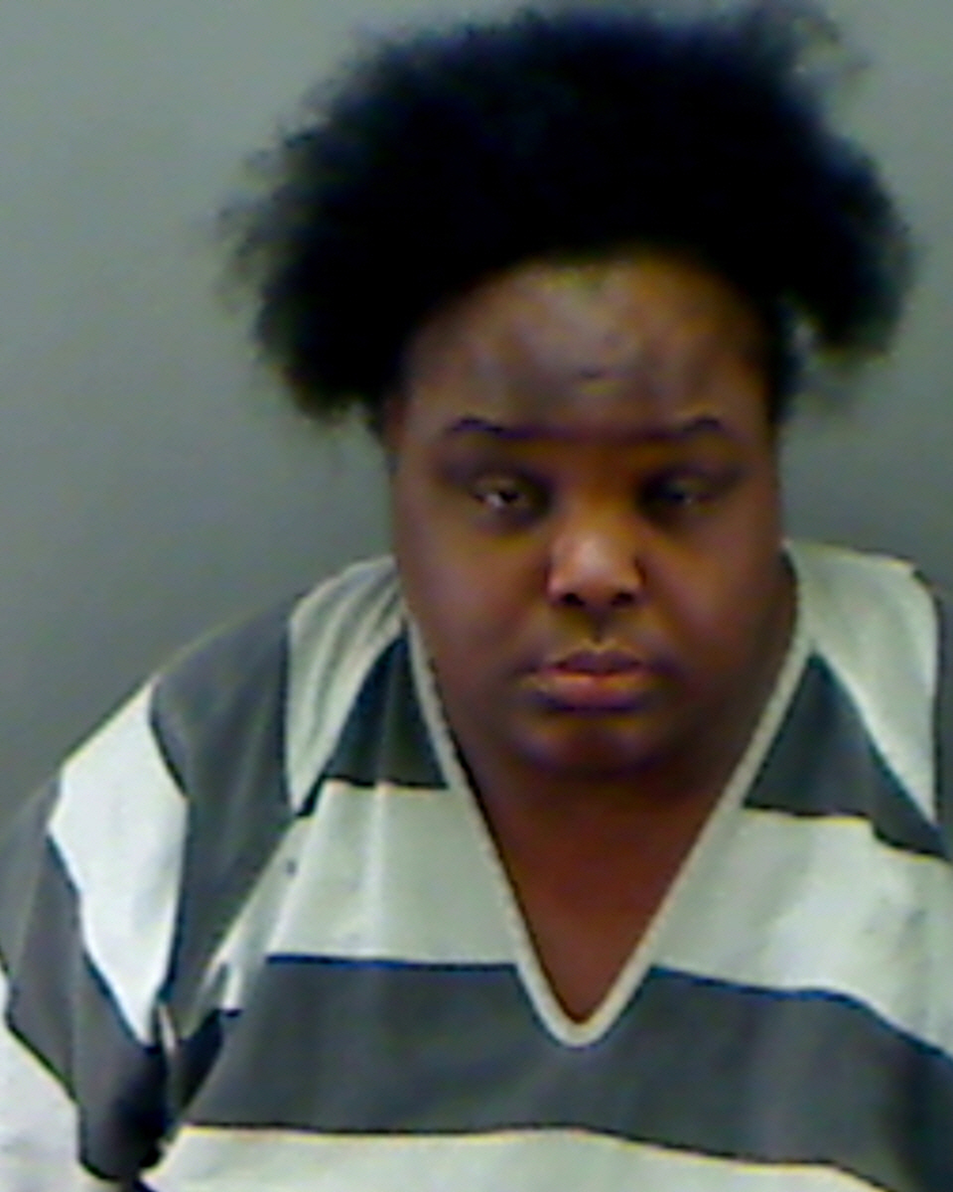 Charity Johnson, 34, is shown in this police booking photo provided by the Longview Police Department in Longview, Texas, on May 15, 2014