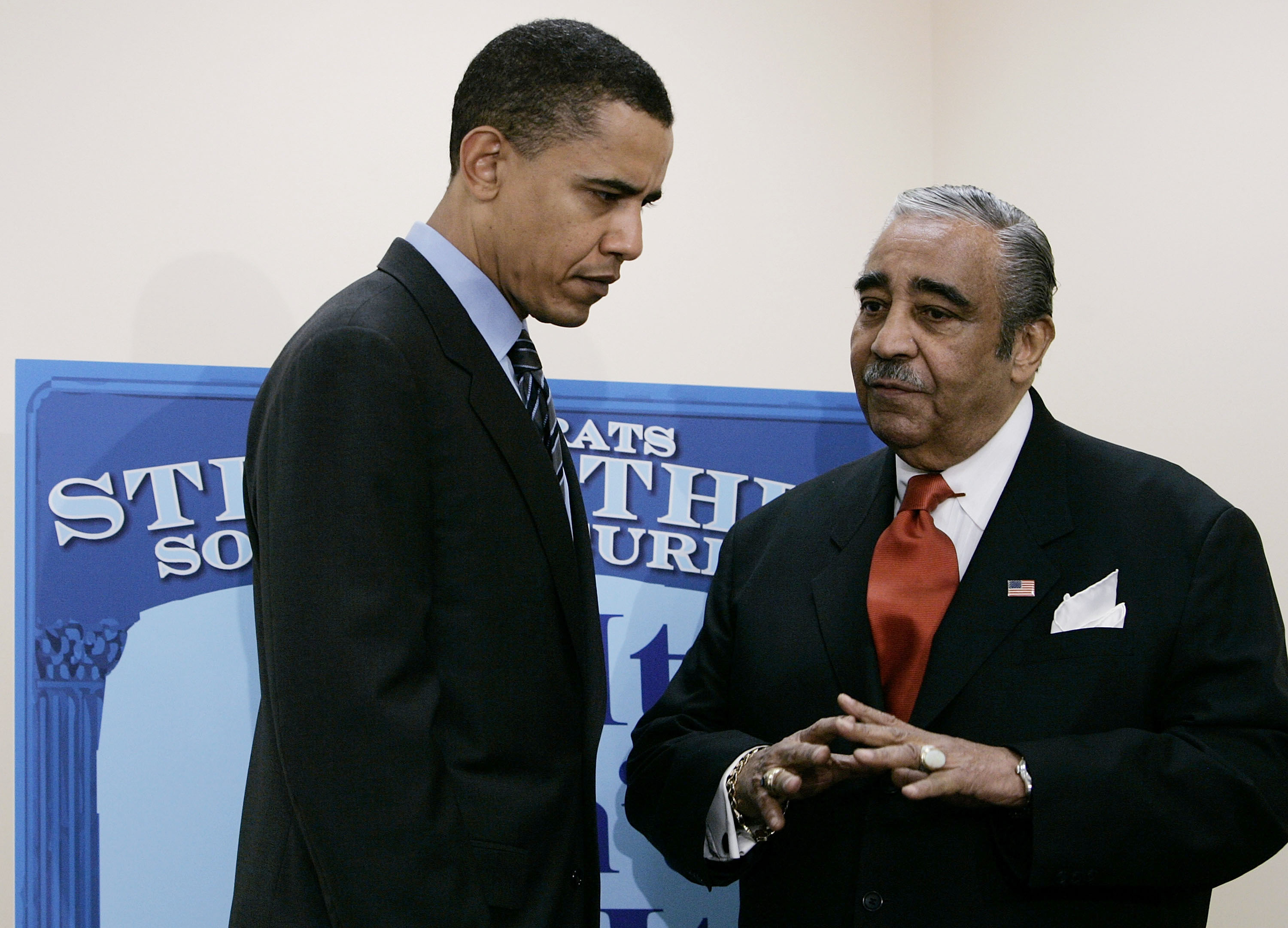 Sen. Barack Obama (D-IL) speaks with Rep. Charles Rangel (D-NY) before the start of a news conference in Washington, March 10, 2005.