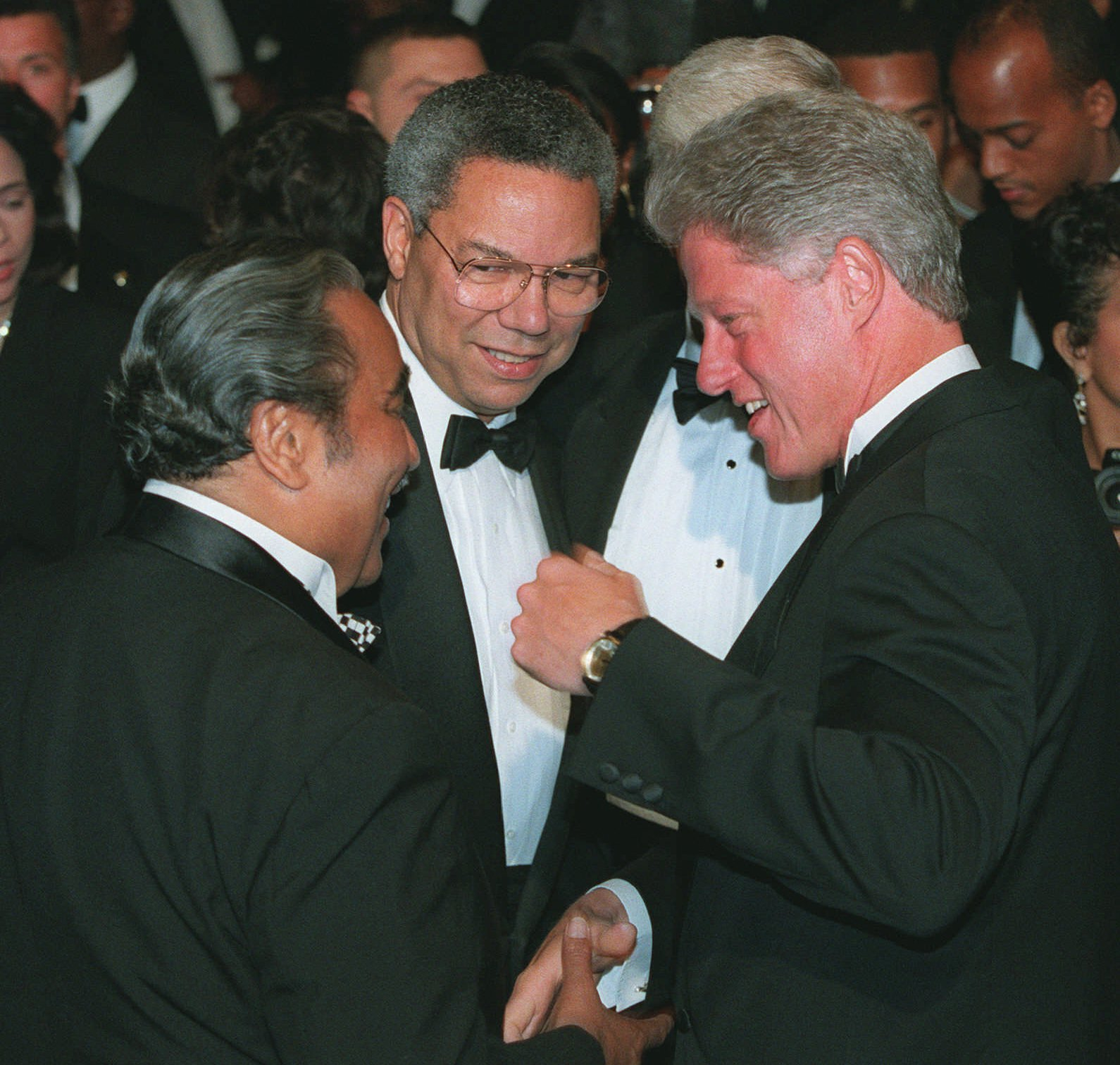 President Clinton talks with Colin Powell, center and Rep. Charles Rangel, D-N.Y., prior to a Congressional Black Caucus dinner in Washington, Sept. 23, 1995.