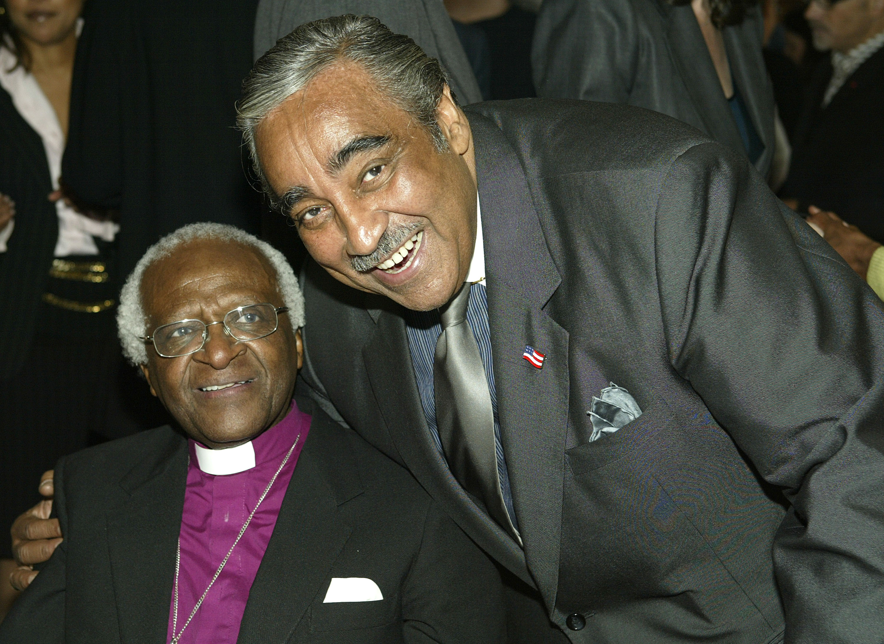 Archbishop Desmond Tutu and congressman Charles Rangel attend the VIP Opening Luncheon before the Tribeca Film Festival at the Tribeca Loft in New York City on May 1, 2004.