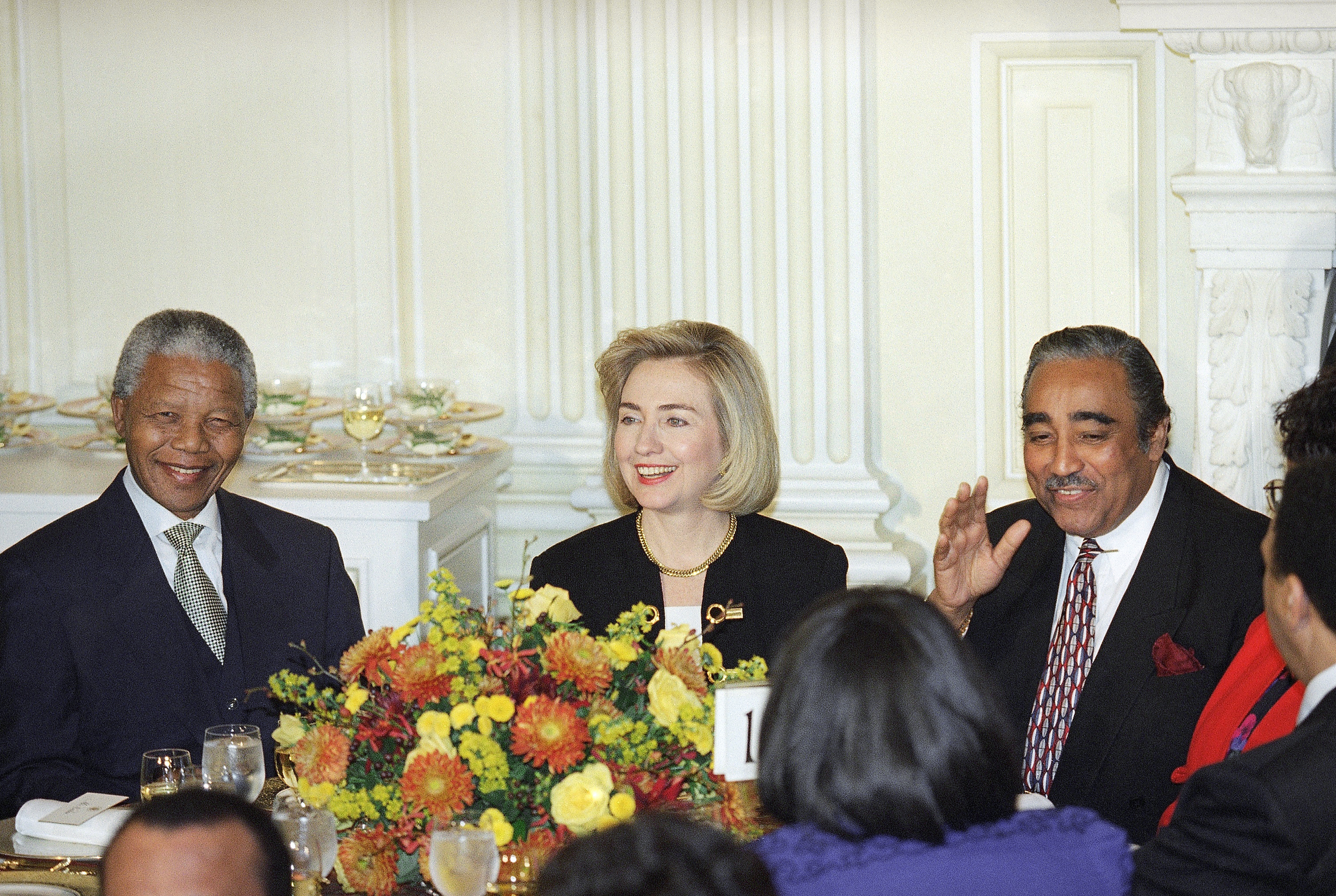 South African President Nelson Mandela, left, and first lady Hillary Rodham Clinton are joined by Rep. Charles Rangel, D-N.Y., during a luncheon at the White House in Washington on Oct. 5, 1994.