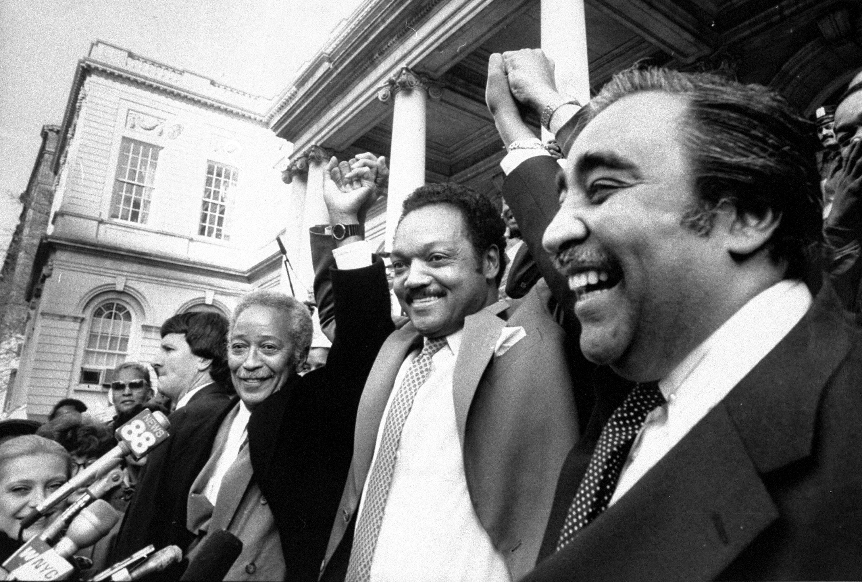 Manhattan Borough President David Dinkins and Rep. Charles Rangel endorse Jesse Jackson for President at City Hall in New York City, Nov. 25, 1987.