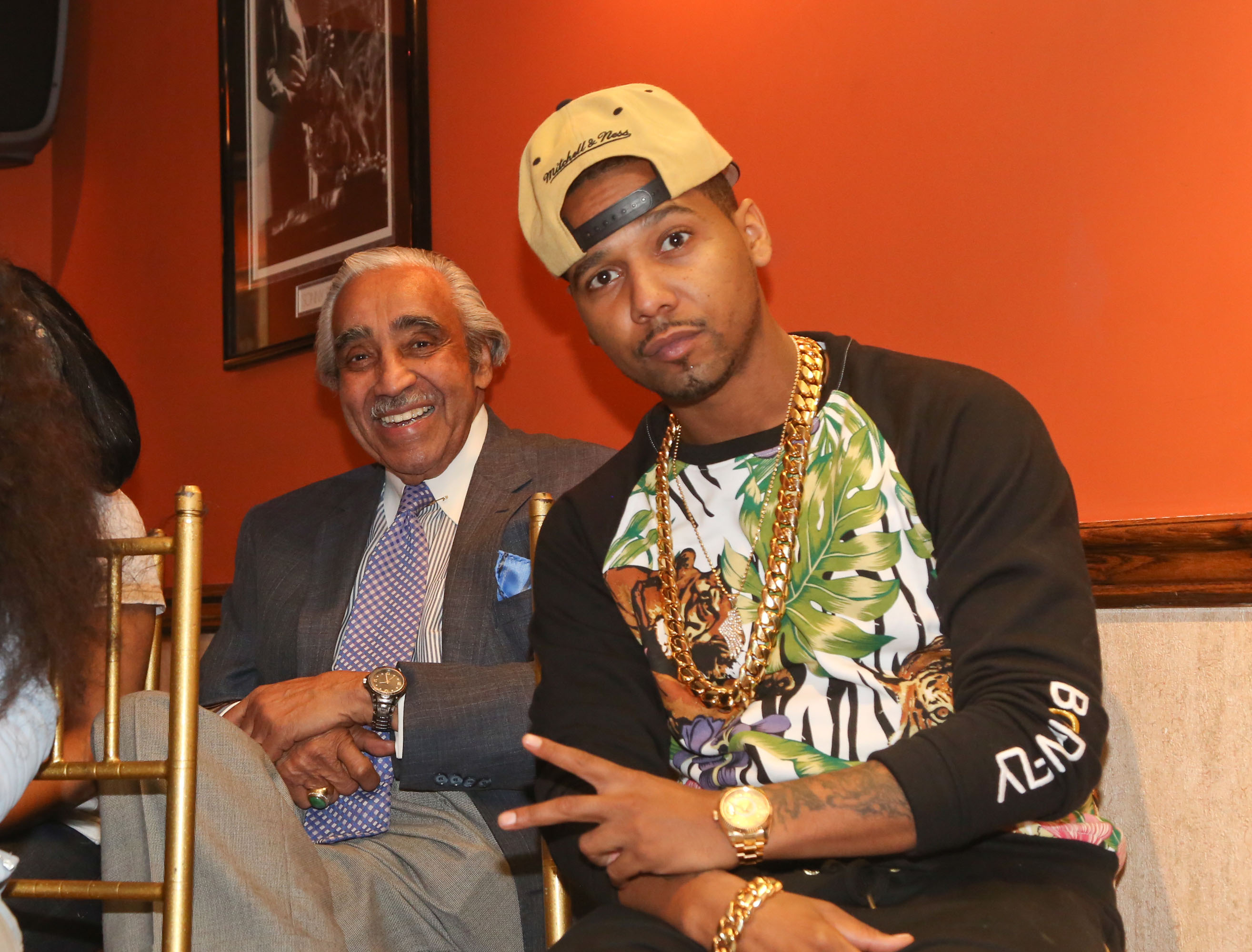Charles Rangel and Juelz Santana attend the #GetCoveredTour press conference at Sylvia's in the Harlem neighborhood of New York City on March 28, 2014.