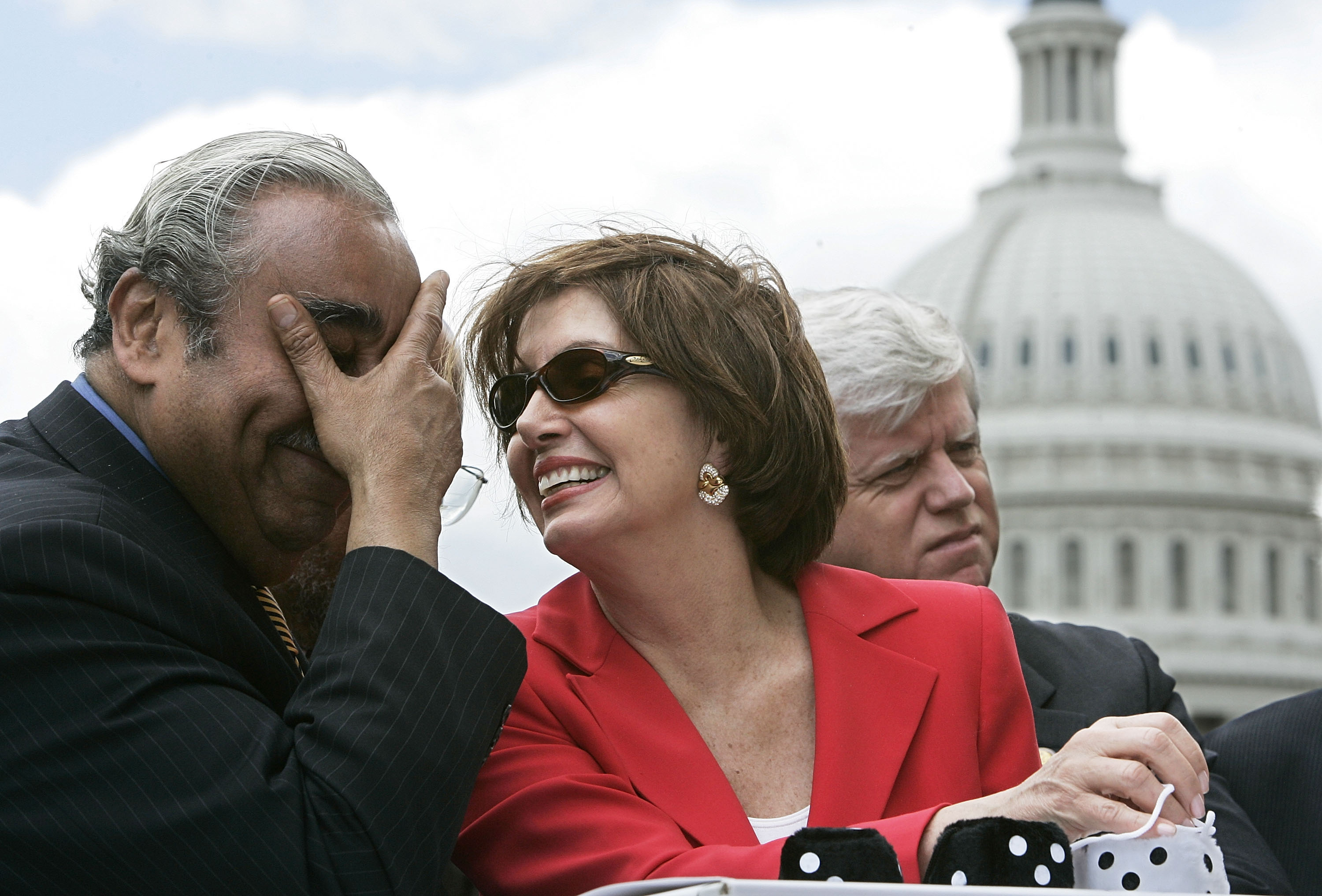 U.S. House Minority Leader Rep. Nancy Pelosi (D-CA) shares a moment with Rep. Charles Rangel (D-NY) as Rep. John Larson (D-CT) listens during a news conference on the reform of the Social Security system on Capitol Hill in Washington,  May 26, 2005.