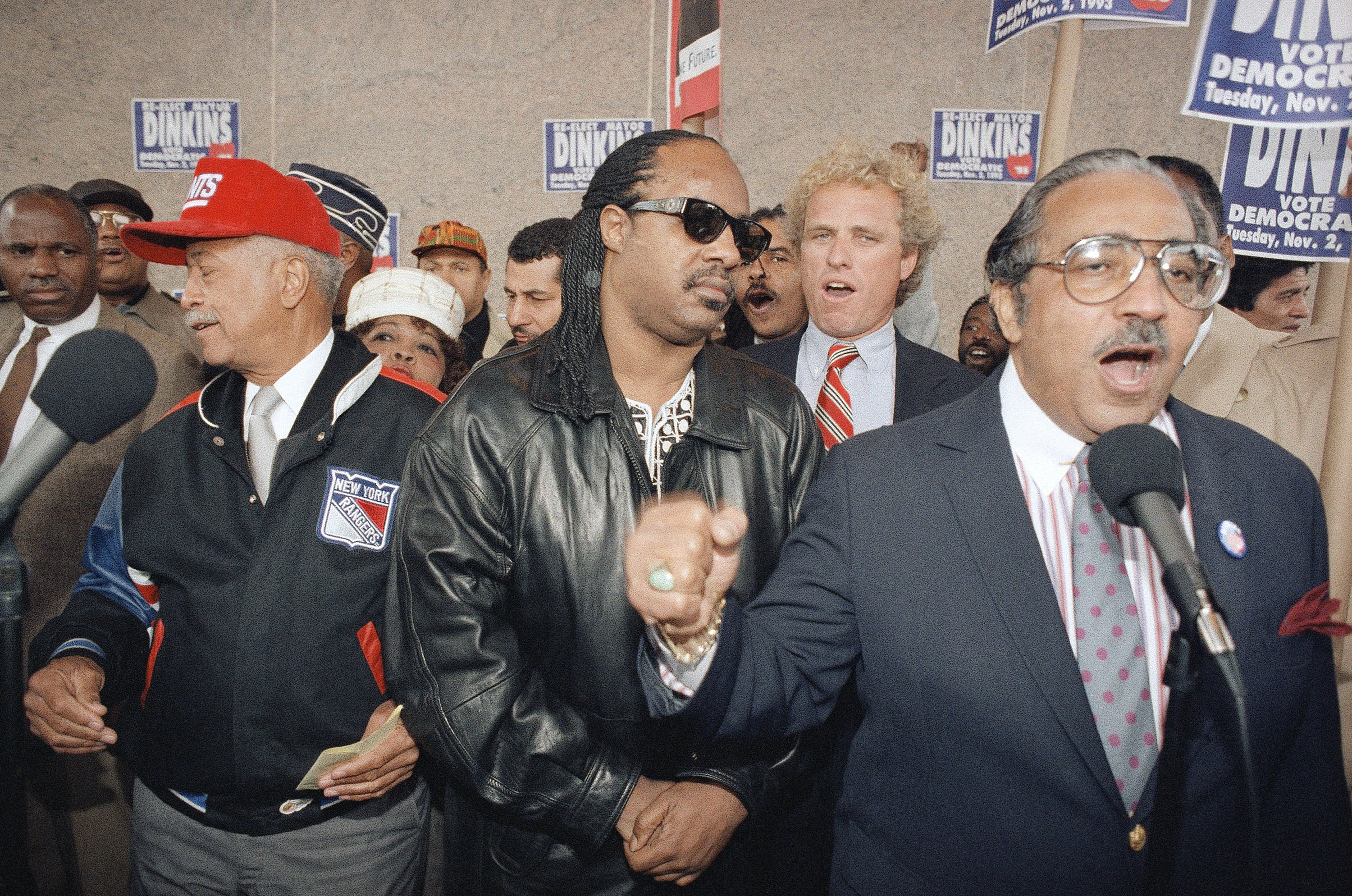 U.S. Congressman Charles Rangel, D-NY, right, voices his support for Mayor David Dinkins, left, along with singer Stevie Wonder, center, at a  Get Out The Vote  rally in the Harlem neighborhood of New York City on Oct. 30, 1993.