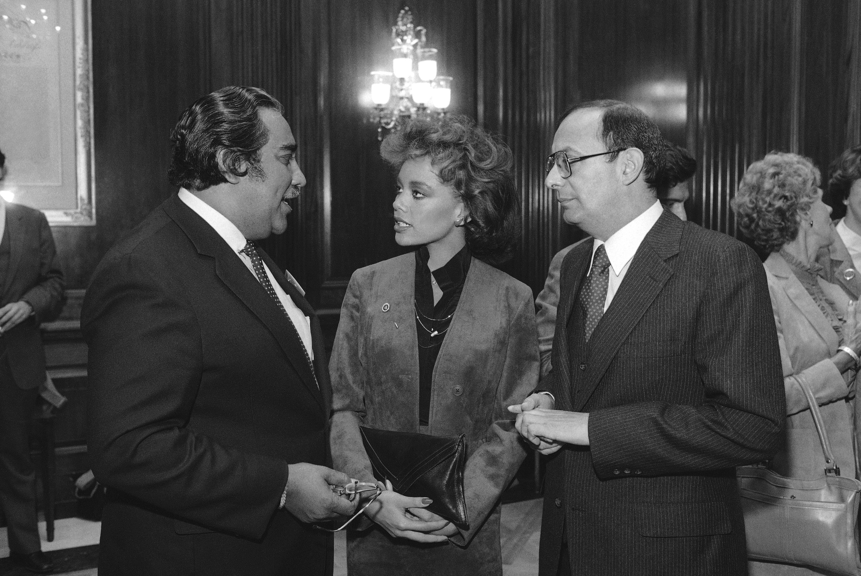 Miss America Vanessa Williams is flanked by Rep. Charles Rangel, D-N.Y., left, and Sen. Alfonse D'Amato, R-N.Y., during a reception on Capitol Hill in Washington, Oct. 17, 1983.