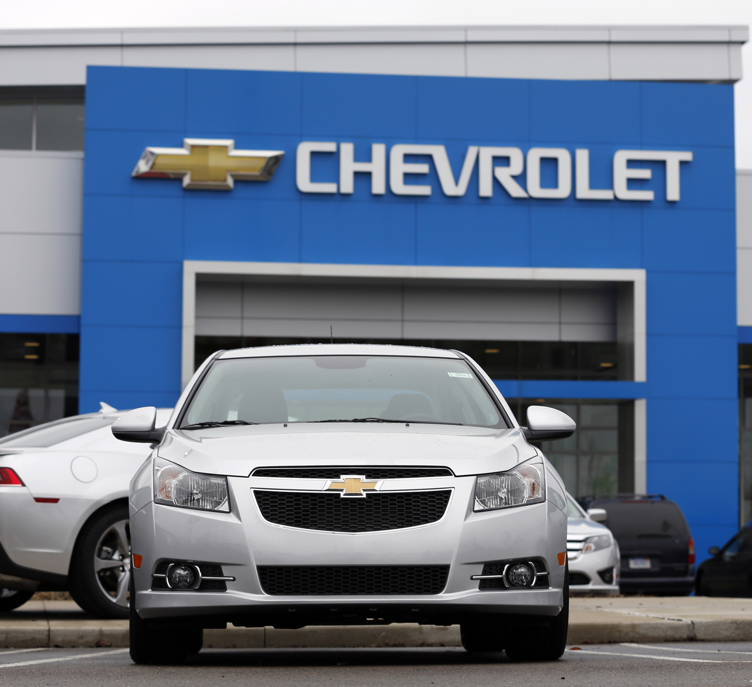 A General Motors Co. 2014 Chevrolet Cruze vehicle sits on the lot at a dealership in Southfield, Michigan, March 28, 2014.