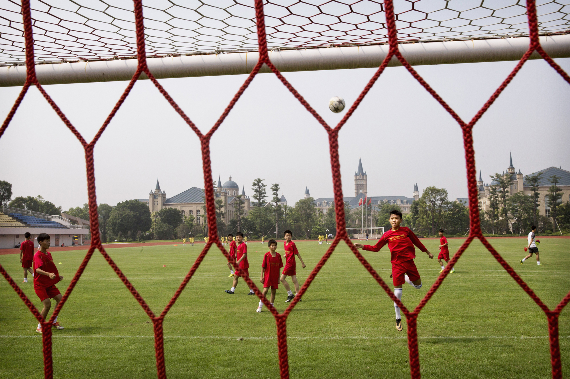 A student heads the ball during training.