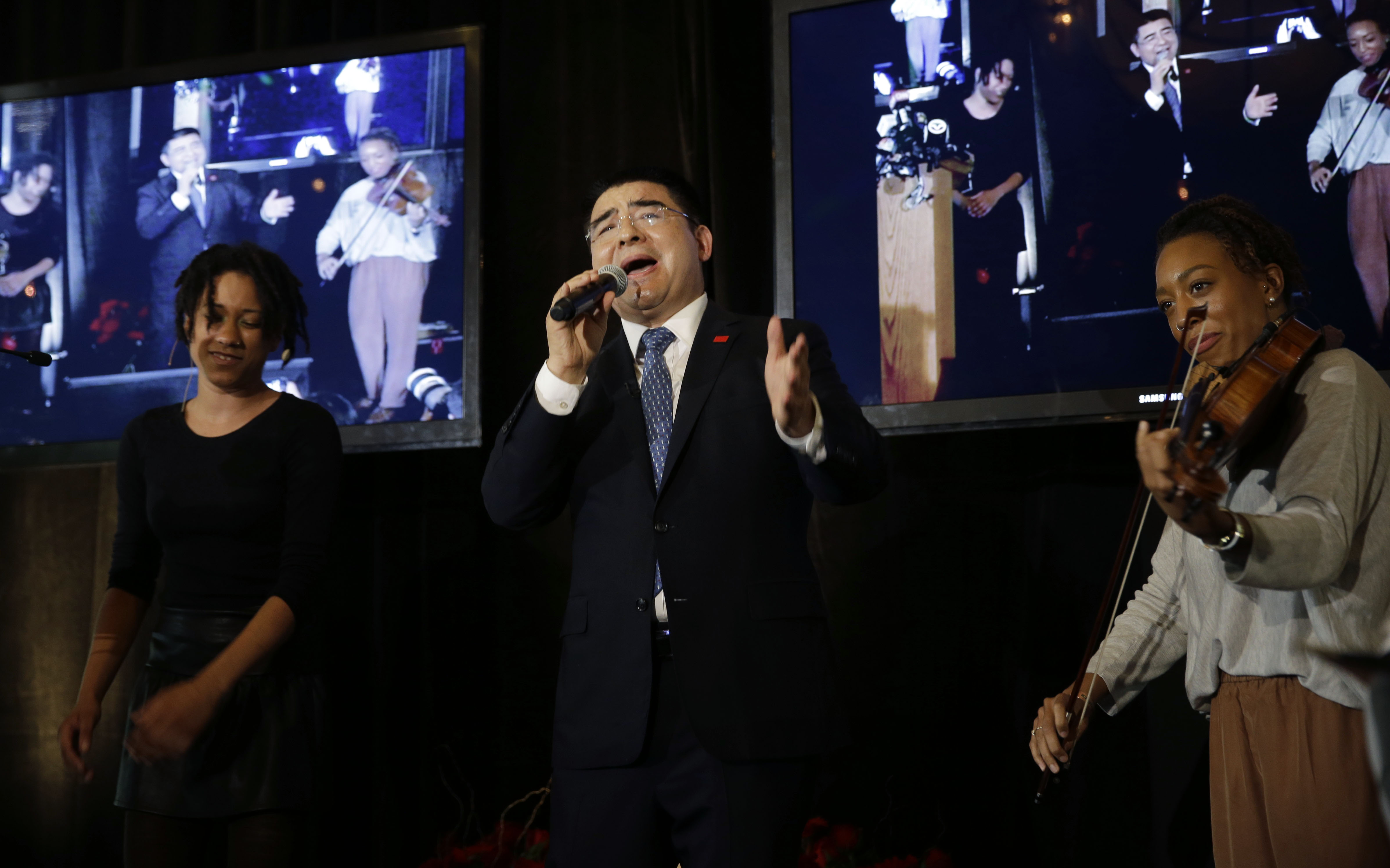 Recycling magnate Chen Guangbiao sings to the media and his guests from the  New York City Rescue Mission at The Loeb Boathouse restaurant in New York, Wednesday, June 25, 2014. The Chinese tycoon known for his sometimes eccentric gestures served up a fancy lunch Wednesday to hundreds of homeless New Yorkers at a Central Park restaurant and serenaded them with  We are the World.  Chen said he wants to disprove the cliche image of rich Chinese spending money mostly on luxuries. (AP Photo/Seth Wenig)