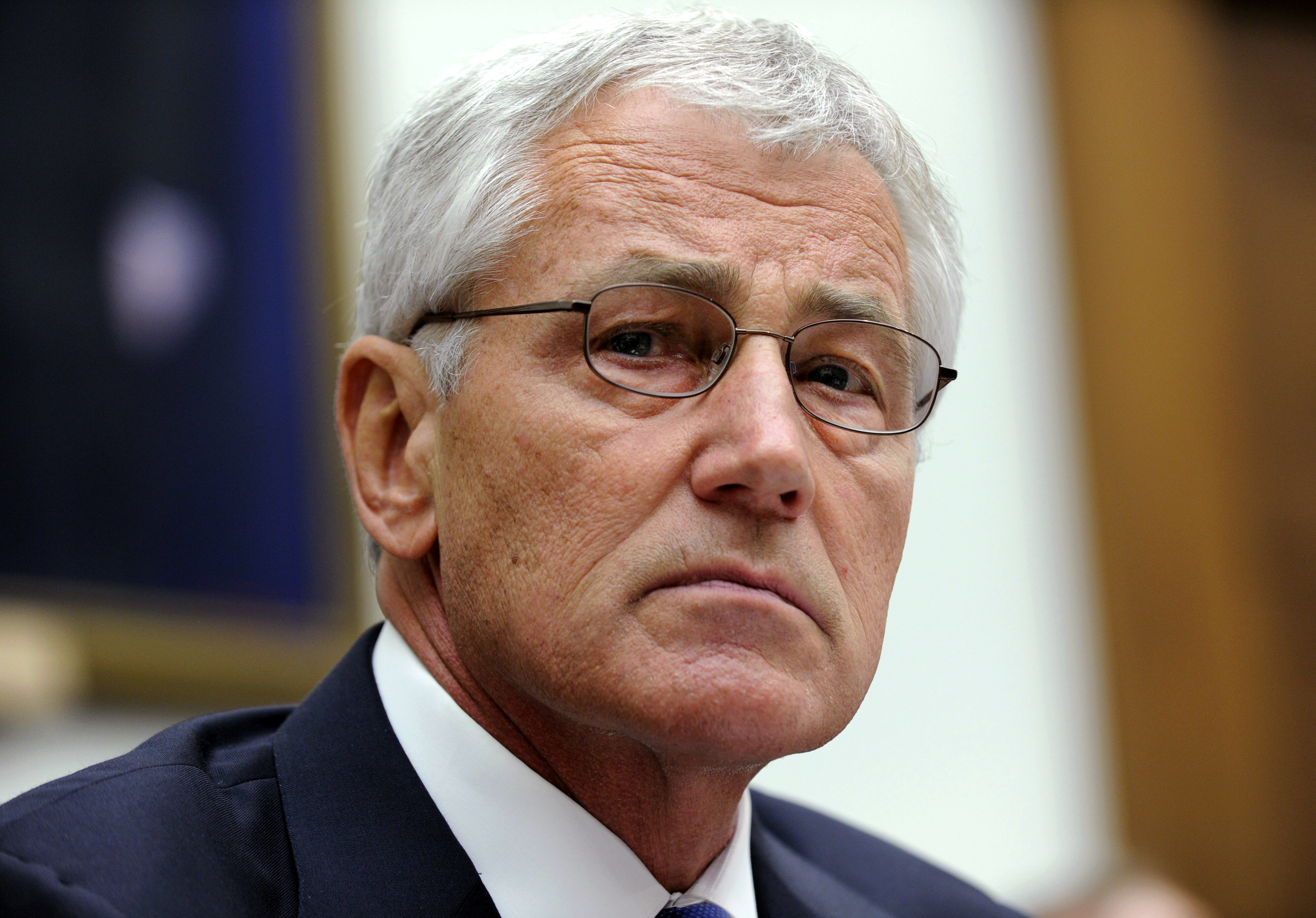 Defense Secretary Chuck Hagel listens to opening statements prior to testifying on Capitol Hill in Washington, June 11, 2014.
