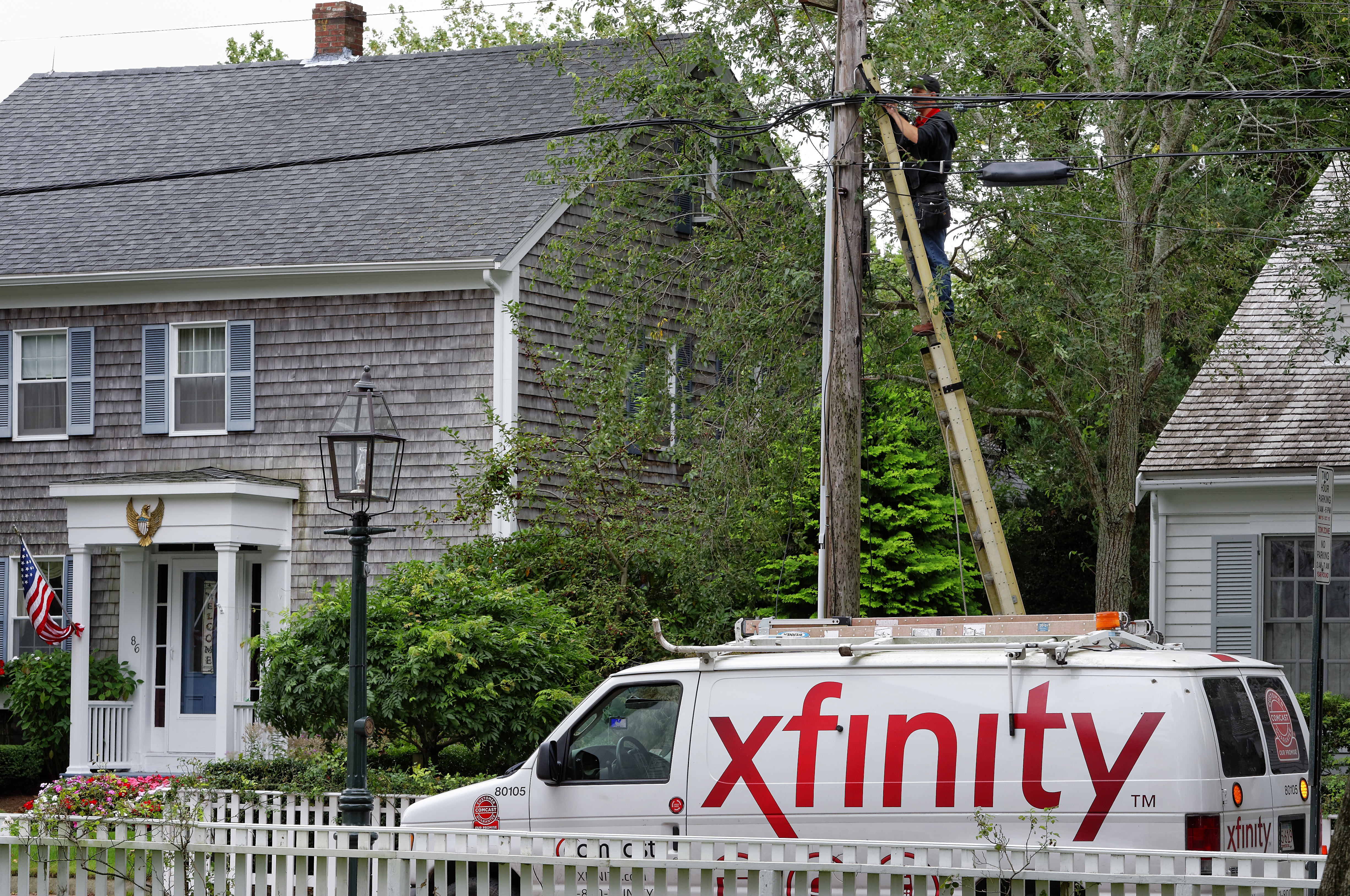 A Comcast worker installs Xfinity into a home.