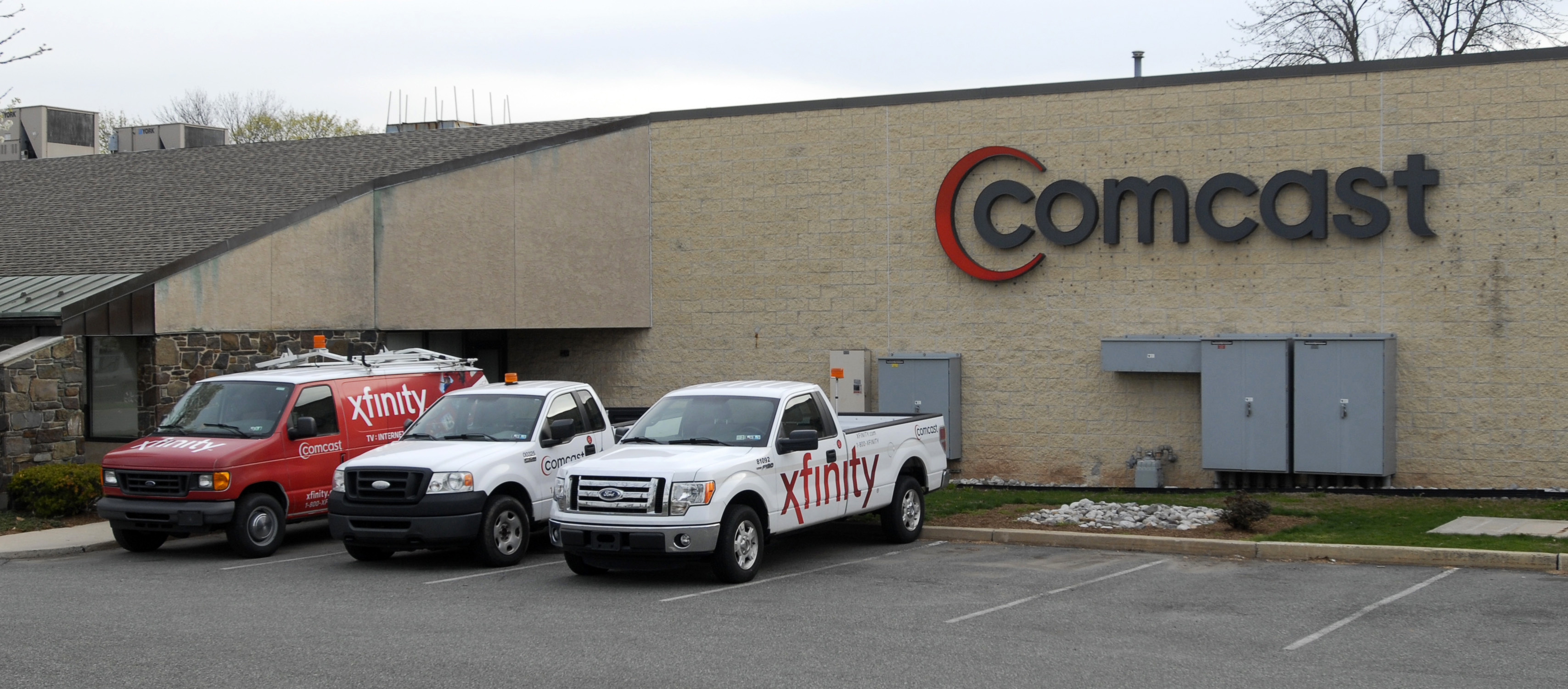 Vehicles with the Xfinity logo, a high-speed internet service offered by Comcast Corp., sit outside a Comcast facility in Pottstown, Pennsylvania, April 22, 2014.