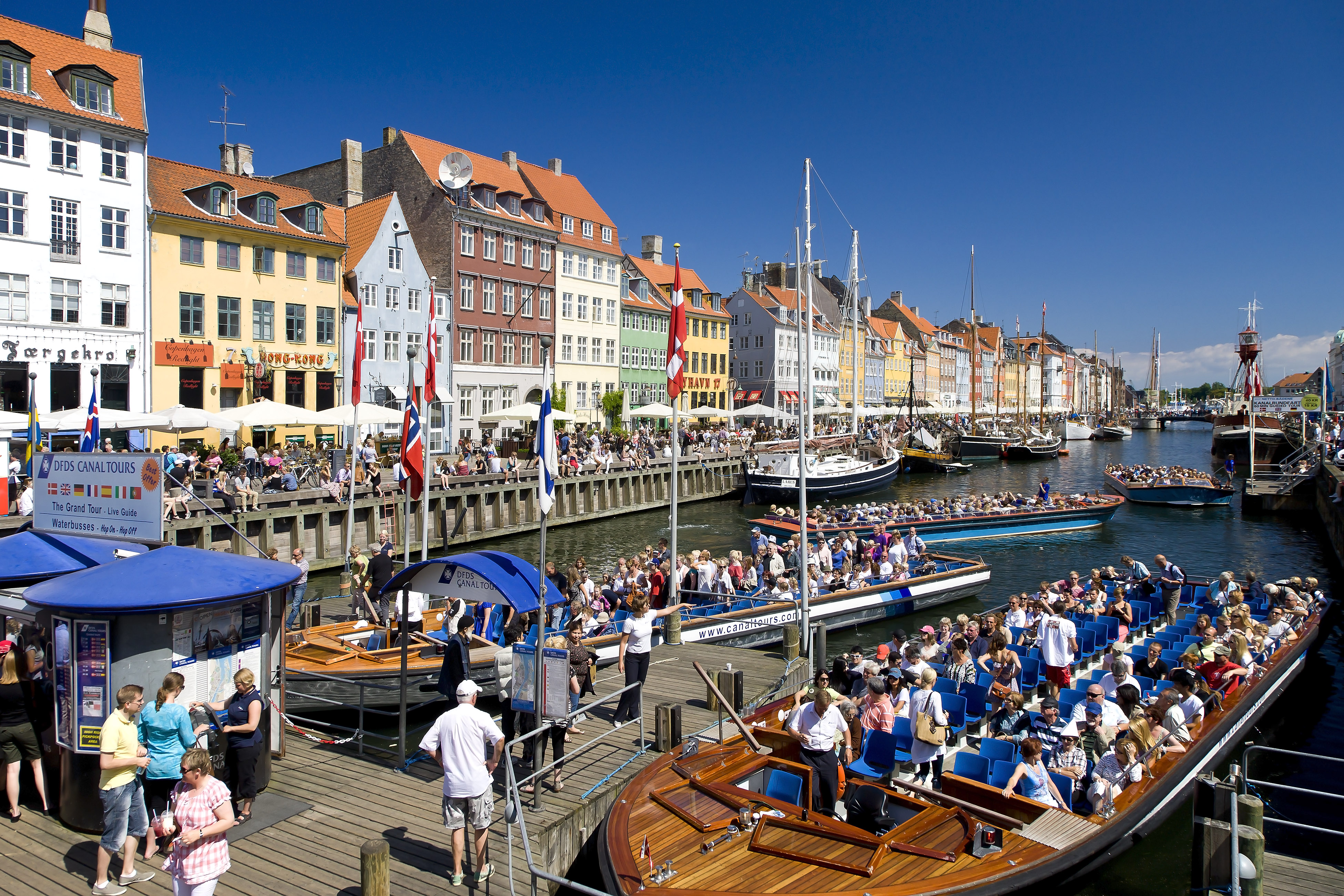 Tourboats in Nyhavn Canal on in Copenhagen on May 7, 2011.