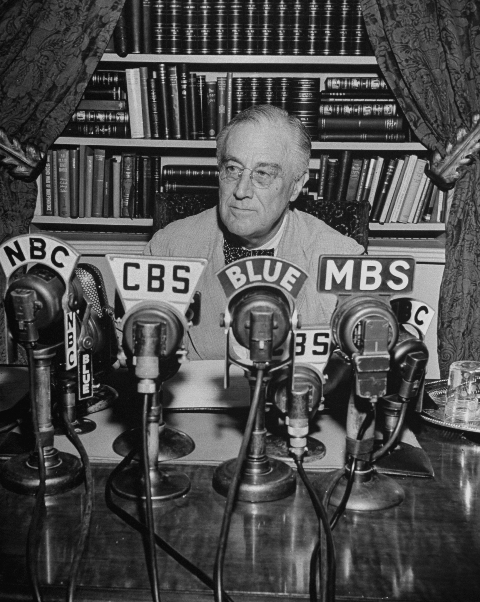 President Franklin D. Roosevelt, broadcasting a speech over the radio from the White House.