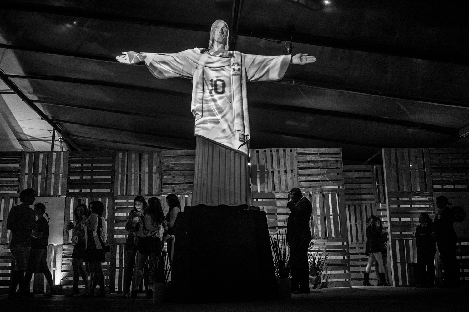 A model of Christ the Redeemer, Rio de Janeiro's most famous monument, dressed in the Brazilian soccer shirt during a night party.