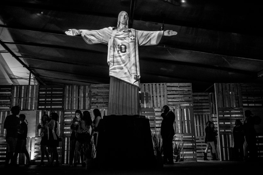 RIO DE JANEIRO, BRAZIL - MAY 2014: The Cristo Redentor, Rio´s most famous momunent, dress with the Brazilian soccer shirt during a night party. (Photo by Sebastián Liste/ Reportage by Getty Images)