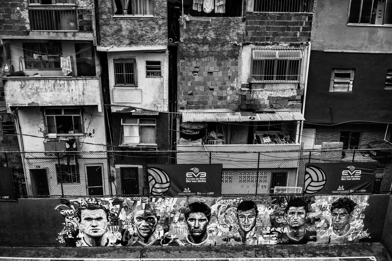 Graffiti of some of the world most famous soccer players including Lionel Messi, Wayne Rooney and Cristiano Ronaldo is seen in the favela of Tavarez Bastos near Rio de Janeiro's downtown.